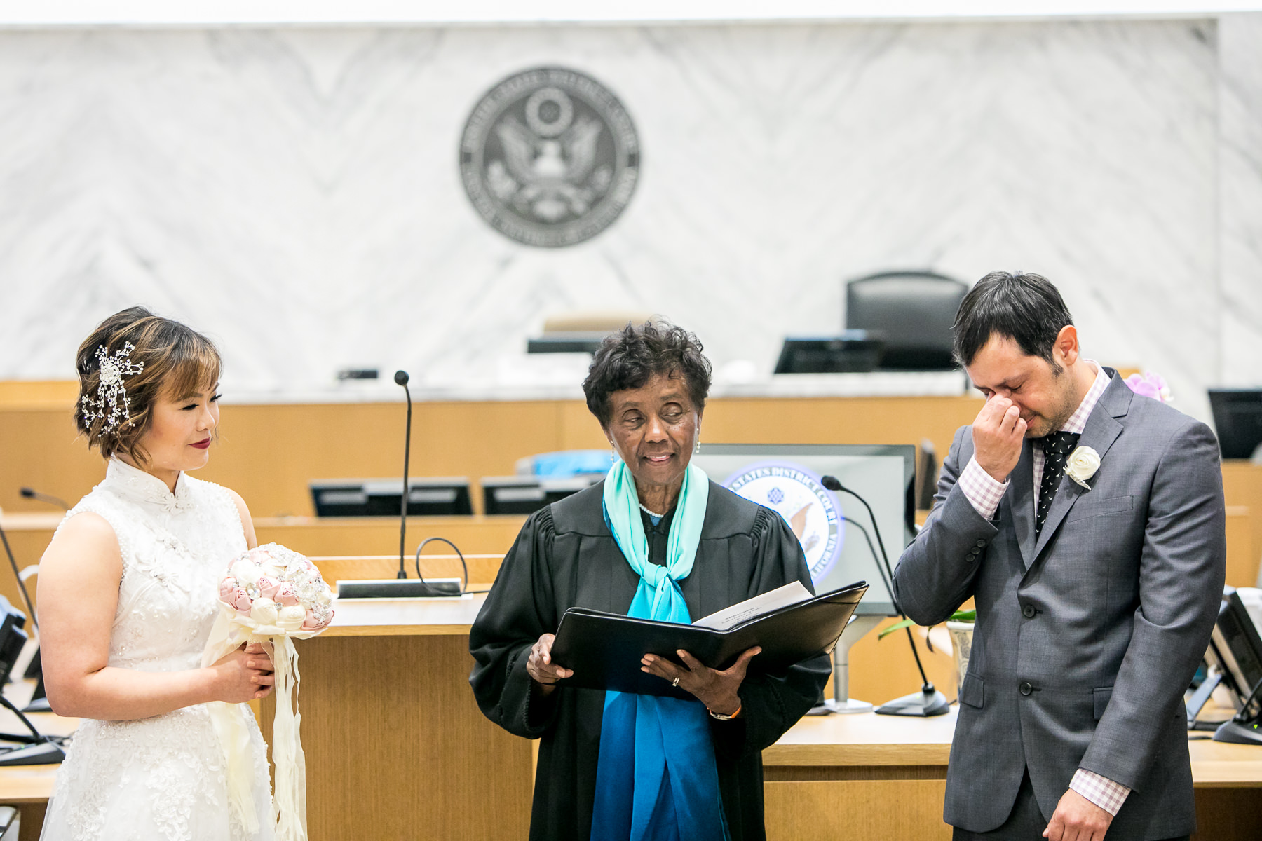 groom cries during civil wedding ceremony in los angeles courthouse wedding