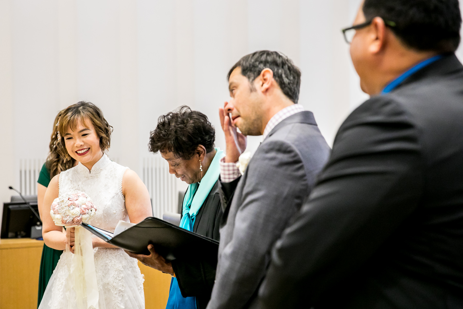 tears of joy from groom while bride smiles during civil ceremony in los angeles