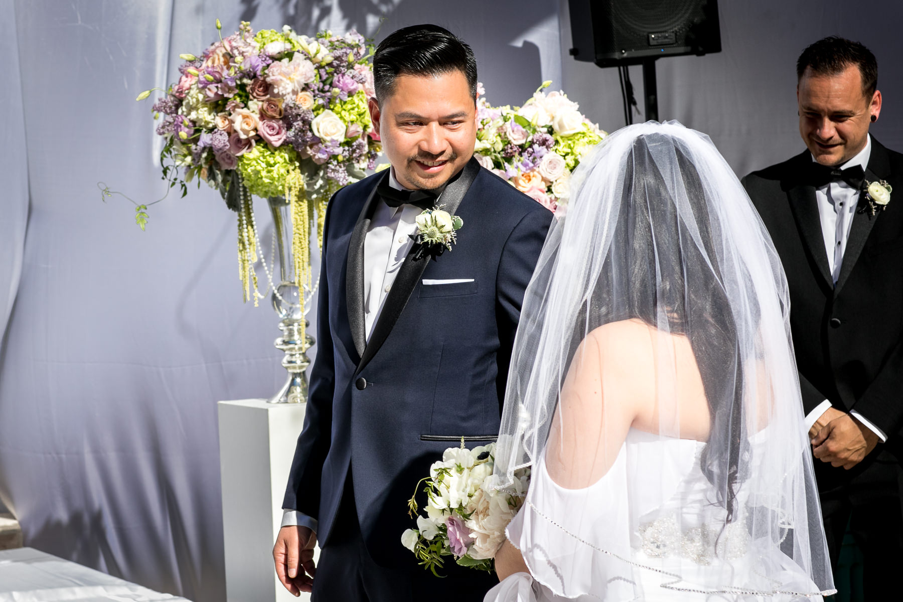 groom sees bride for first time walking down the aisle at noor pasadena wedding photo
