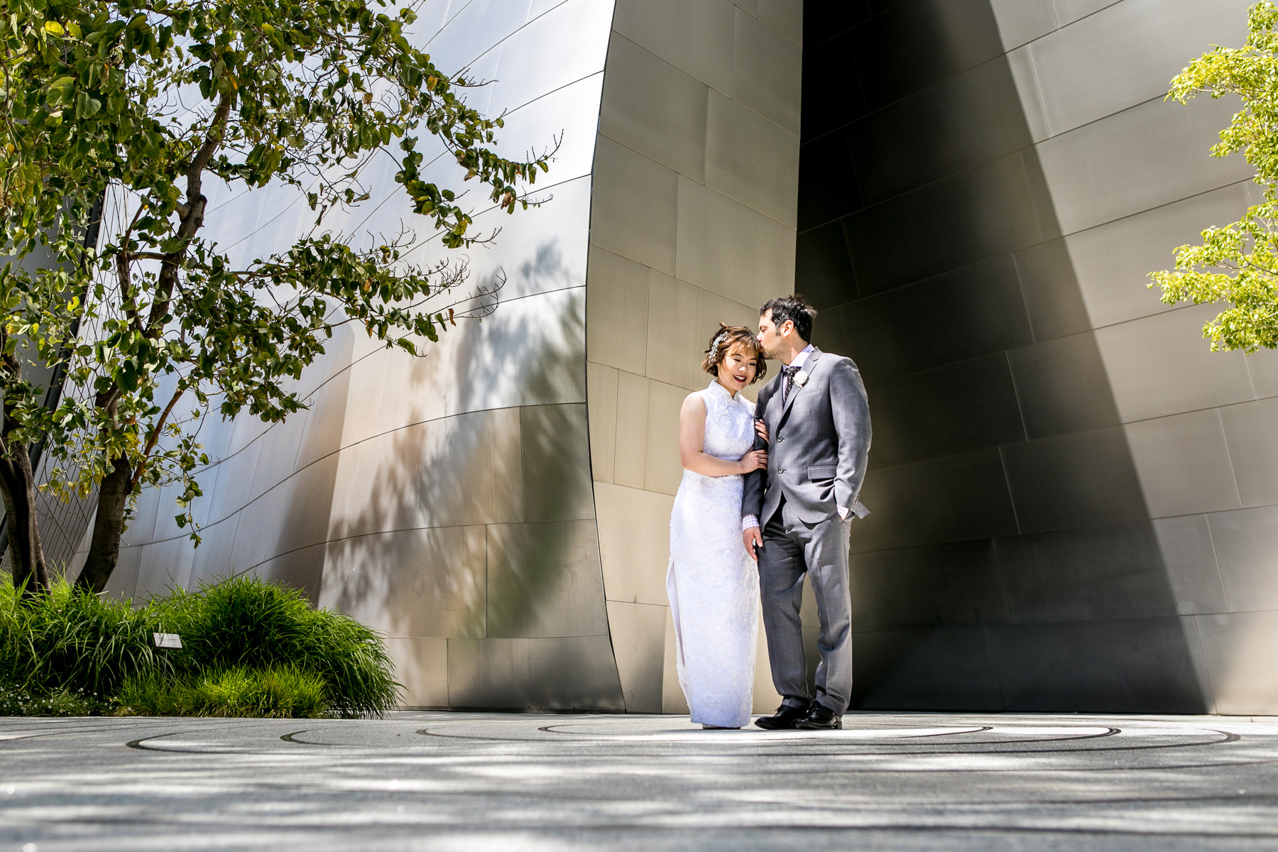 wide shot of lovely bride and groom sharing intimate moment at walt disney concert hall wedding