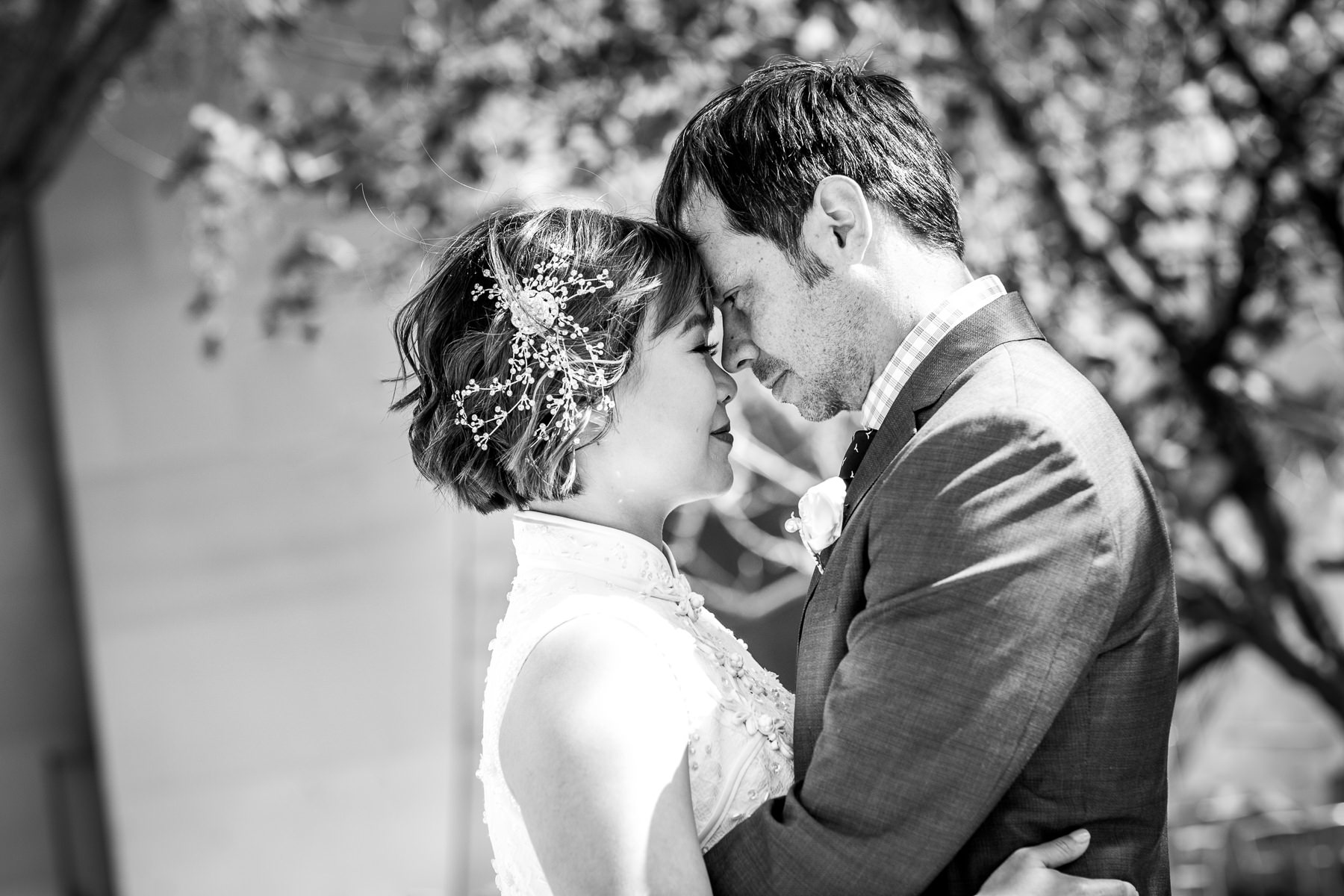 black and white photo of bride and groom looking into each other's eyes after wedding at disney concert hall