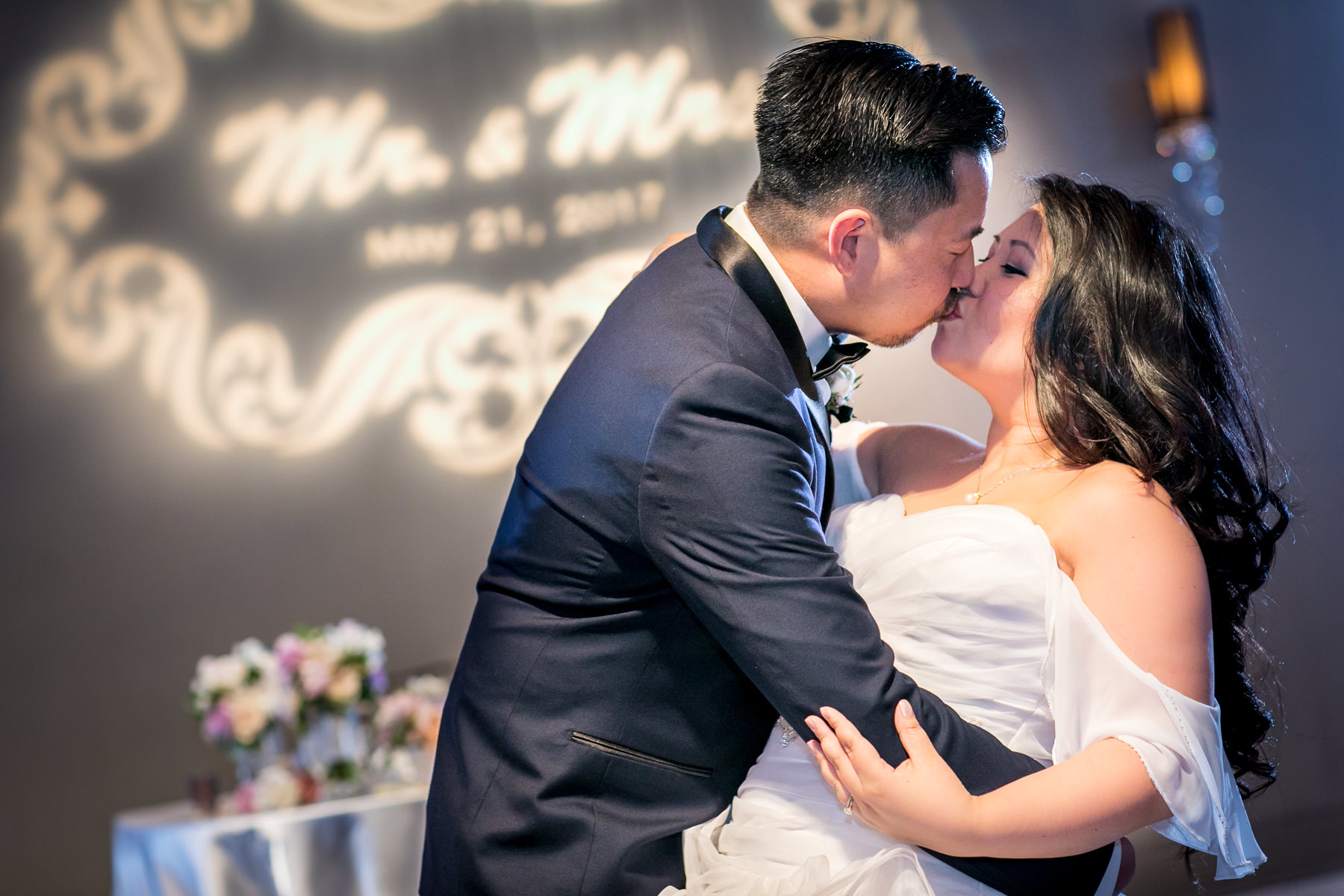 groom dips and kisses bride during first dance at noor pasadena wedding photography
