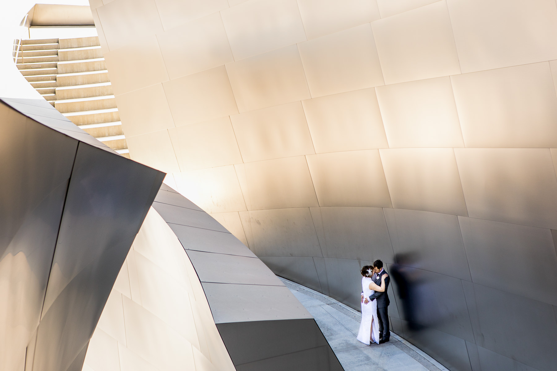 wide shot of couple sharing intimate moment after wedding at walt disney concert hall photographer