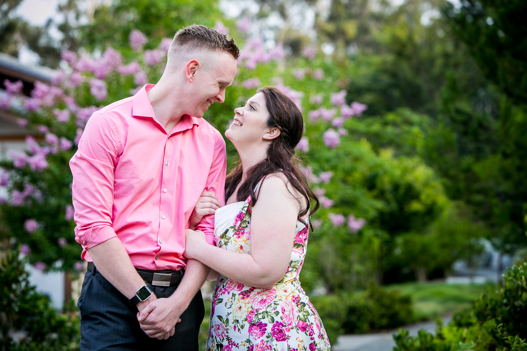 couple glances into each other's eyes during balboa park engagement session photo