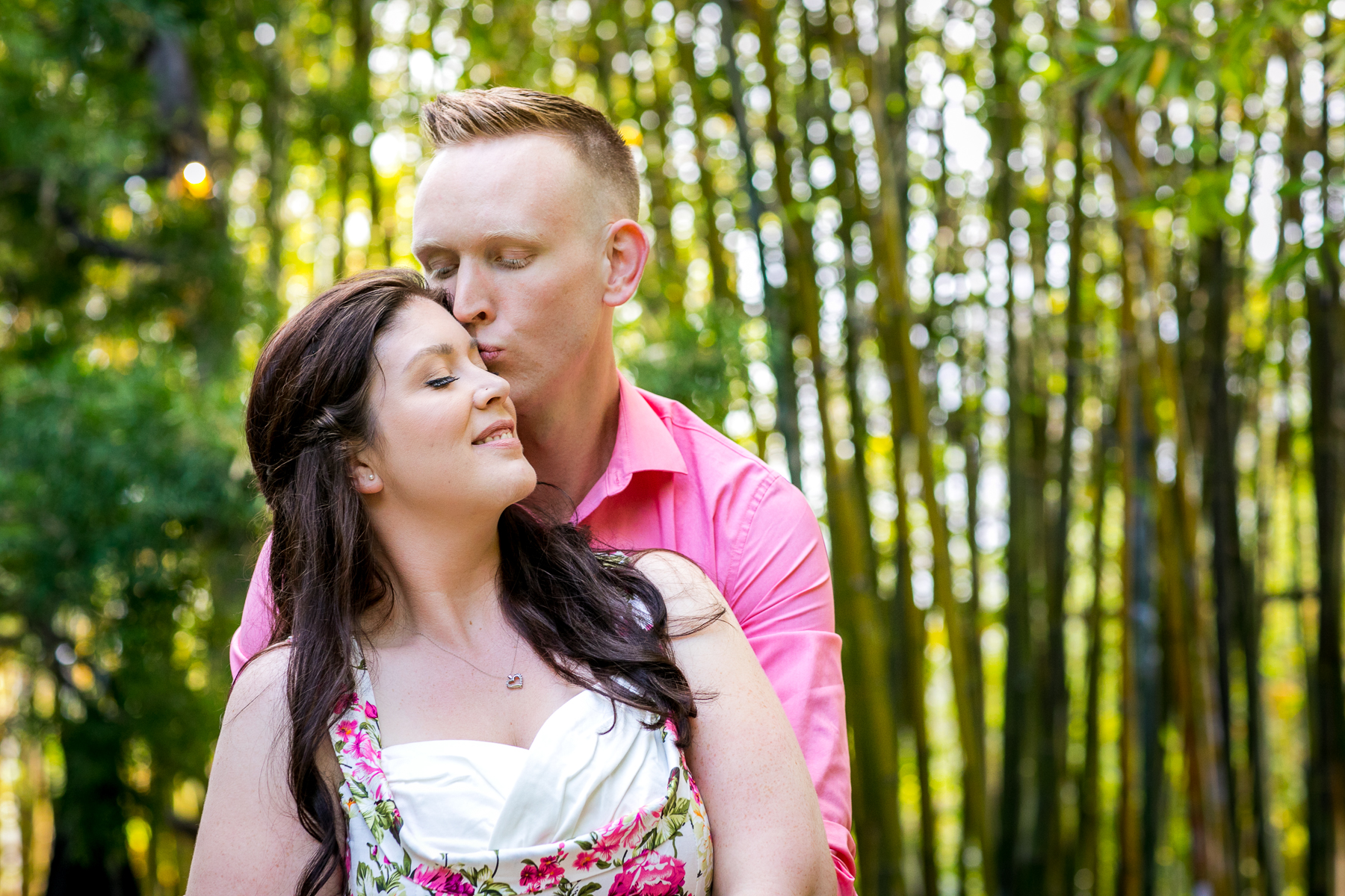 lovely couple share intimate moment in front of bamboo for san diego engagement session