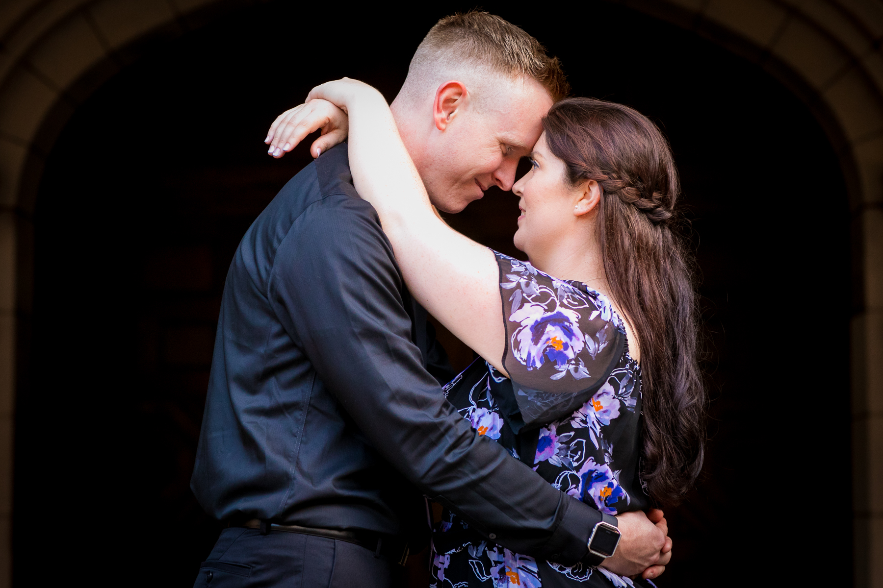 couple gazes into each other's eyes during balboa park engagement session photos