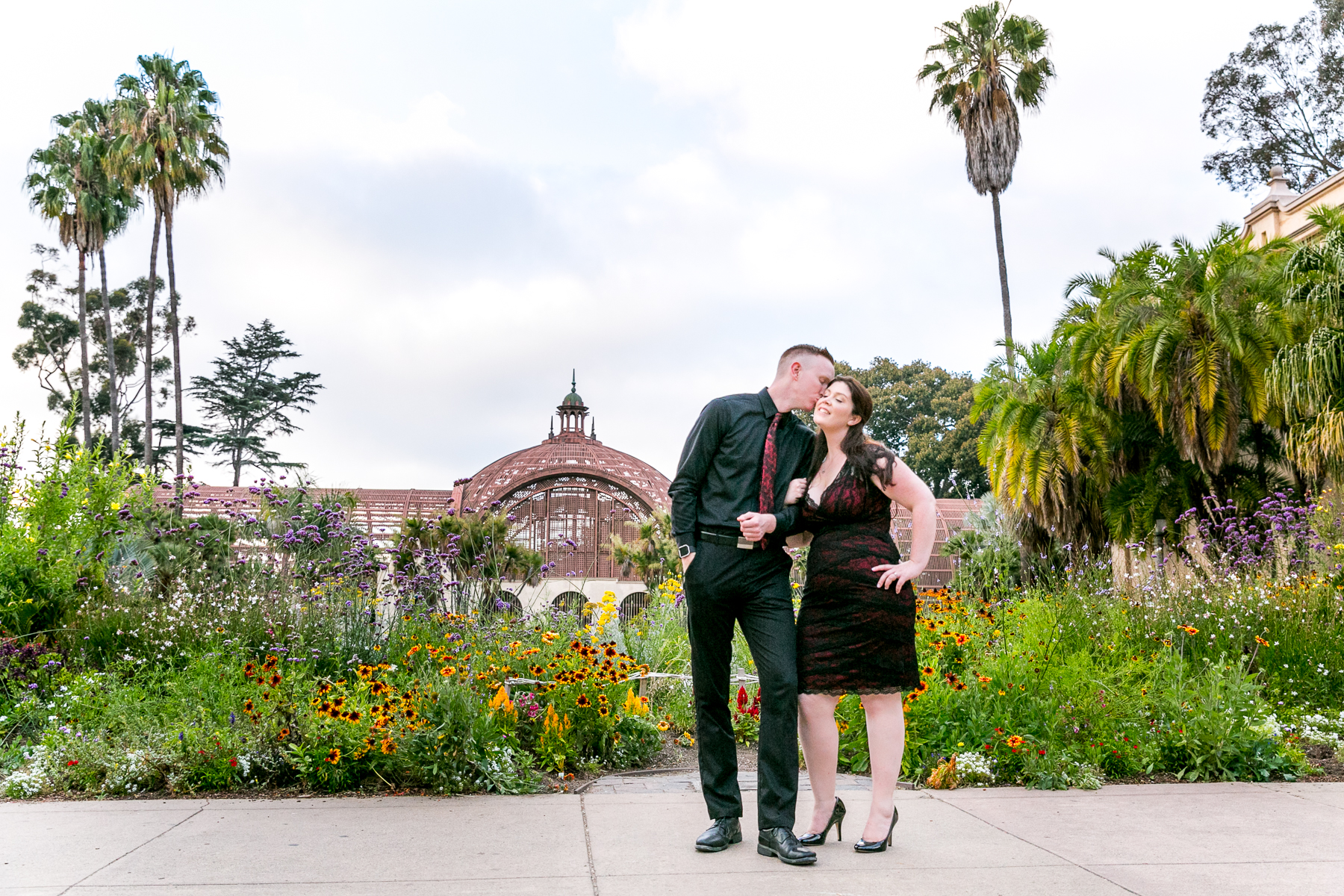 wide shot of engaged couple at balboa park during engagement session in san diego
