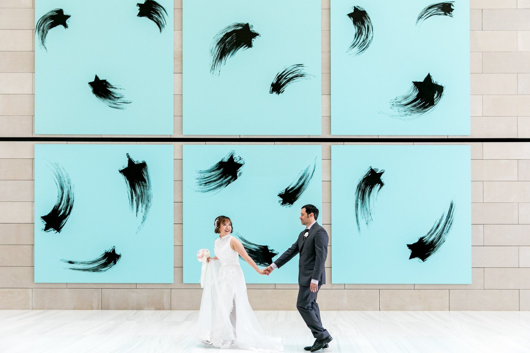 bride and groom in front of art gallery in los angeles wedding photographer