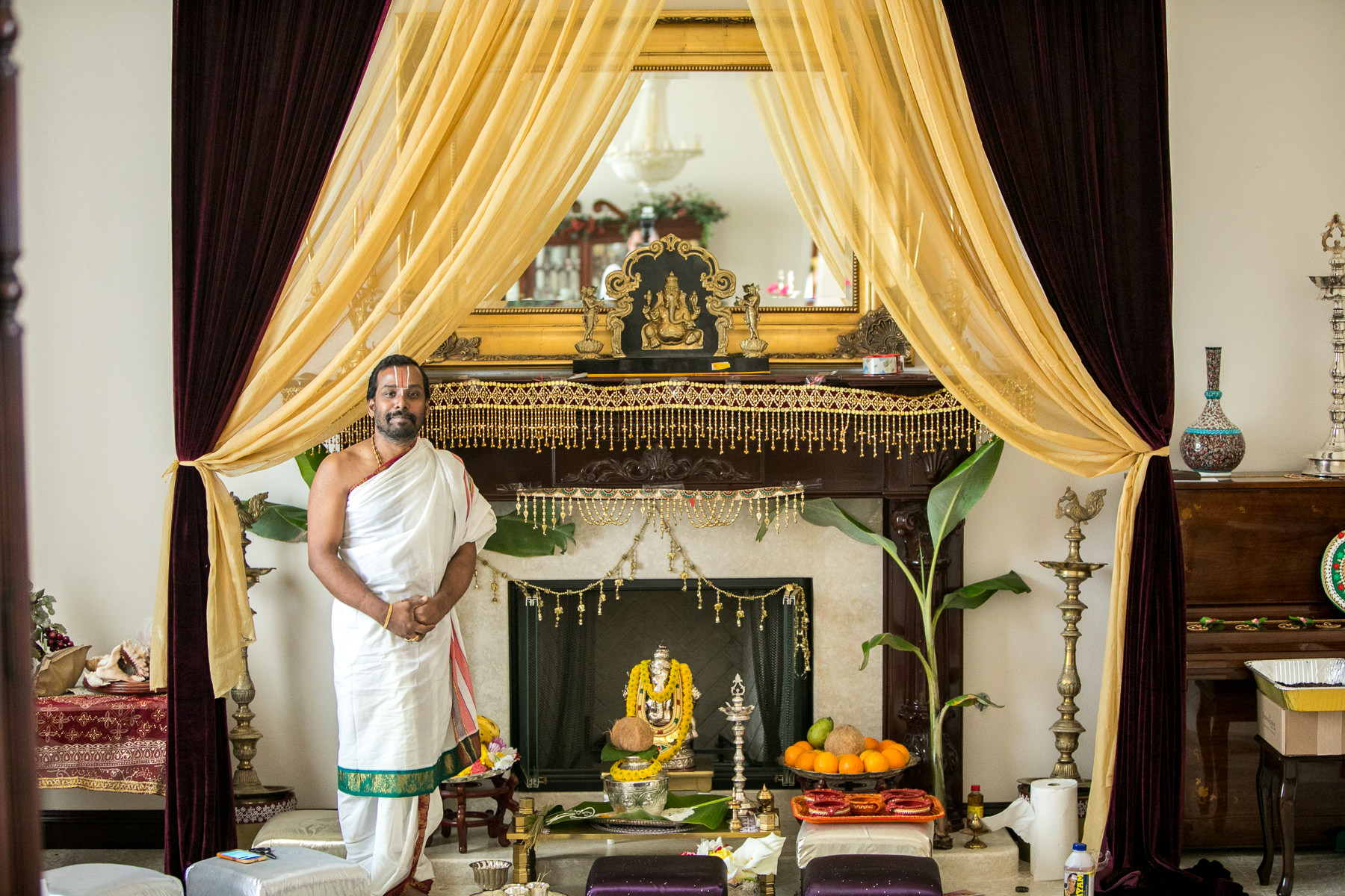 sadhu in front of alter for hindu wedding photographer