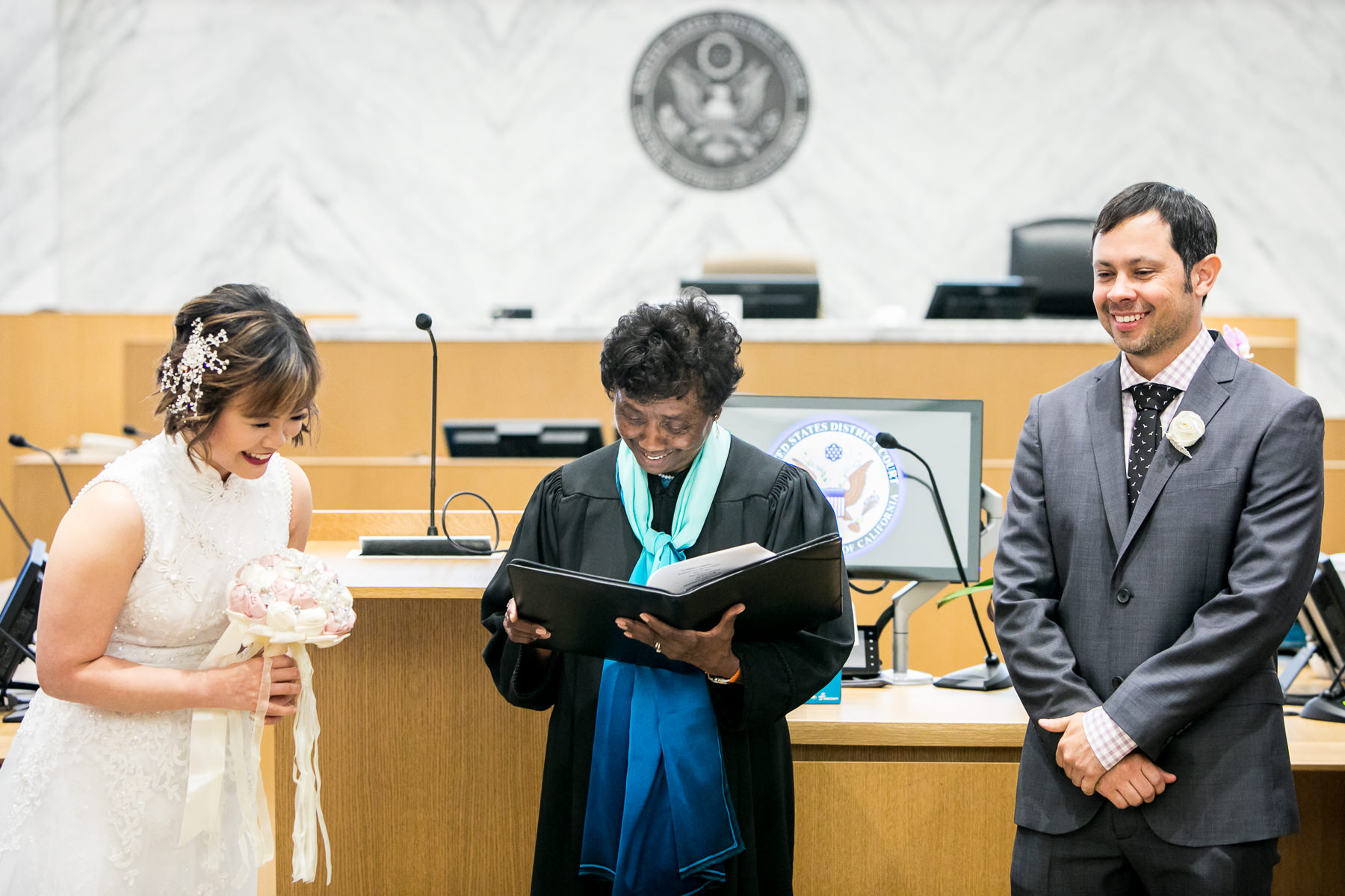 bride and groom laugh at what they mean to each other narration during los angeles wedding photo