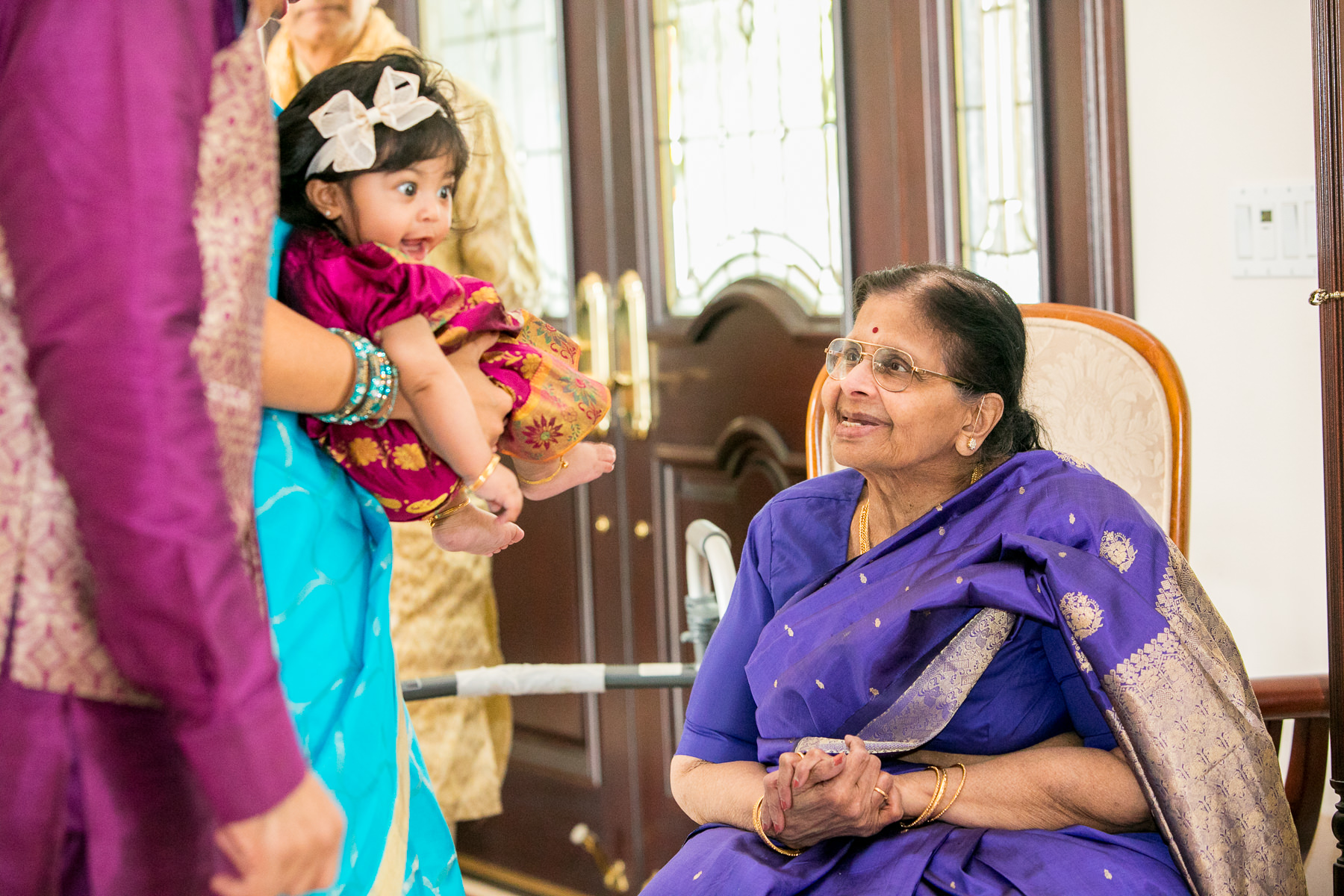 great grandmother with great granddaughter during wedding day