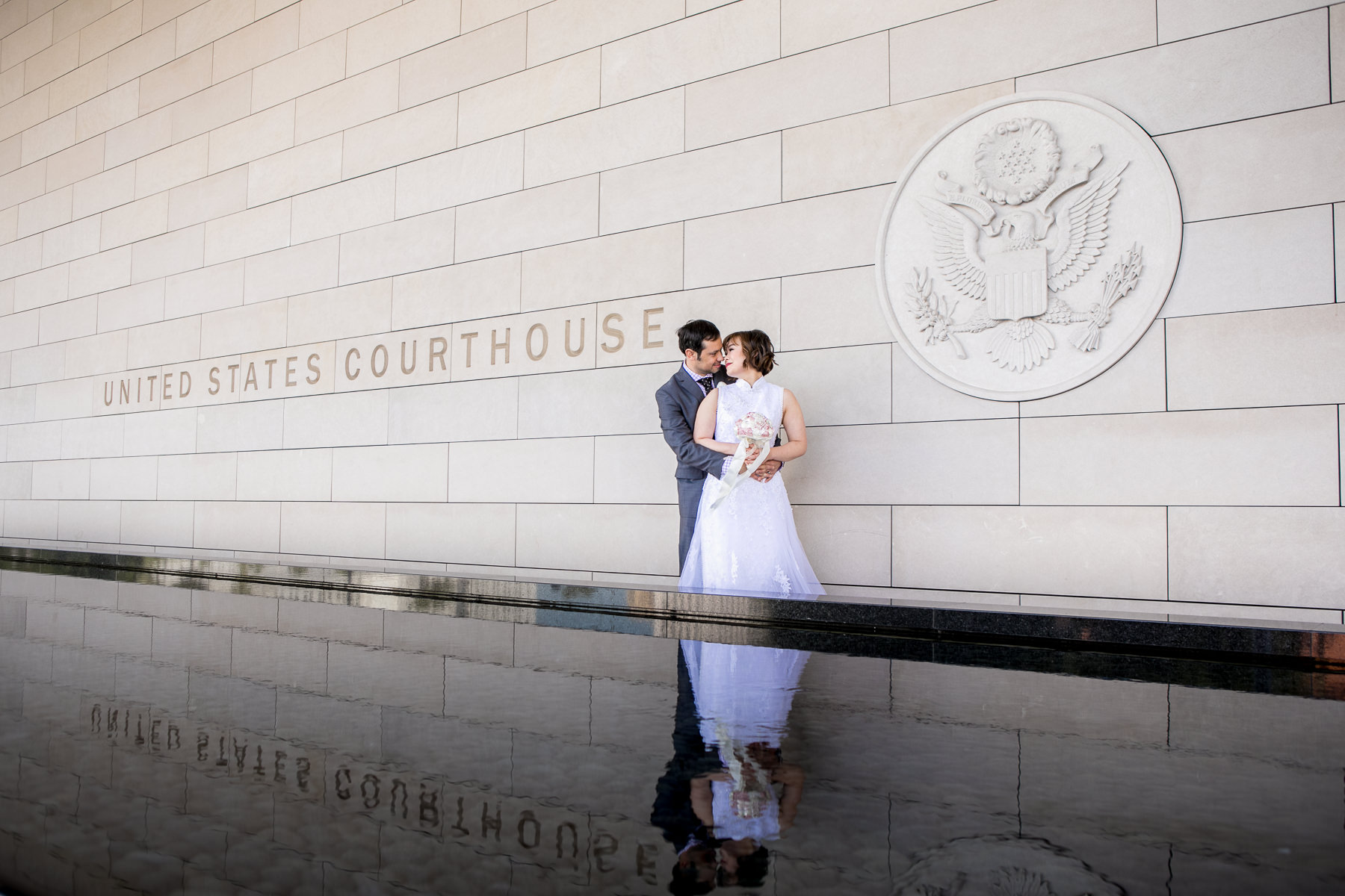 creative reflection shot in front of los angeles courthouse wedding photo
