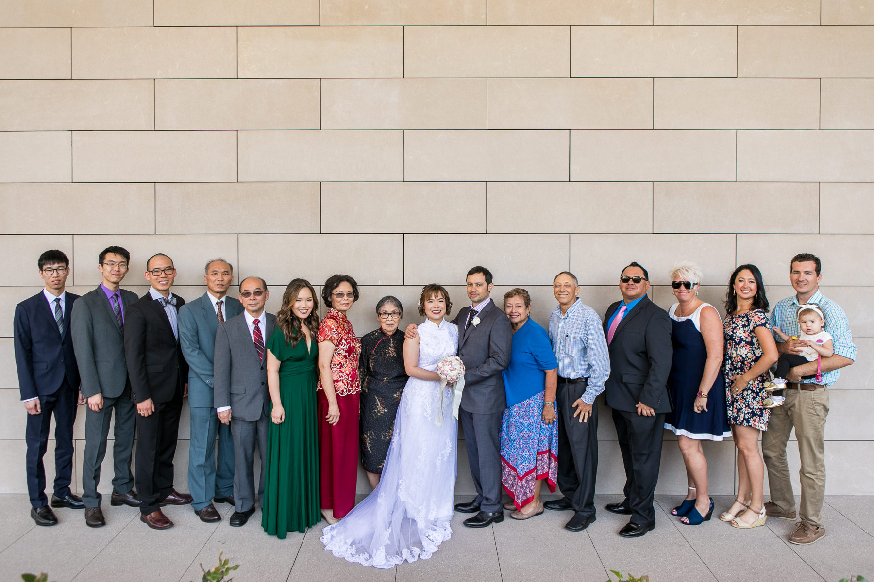 group family photo with bride and groom after wedding in los angeles