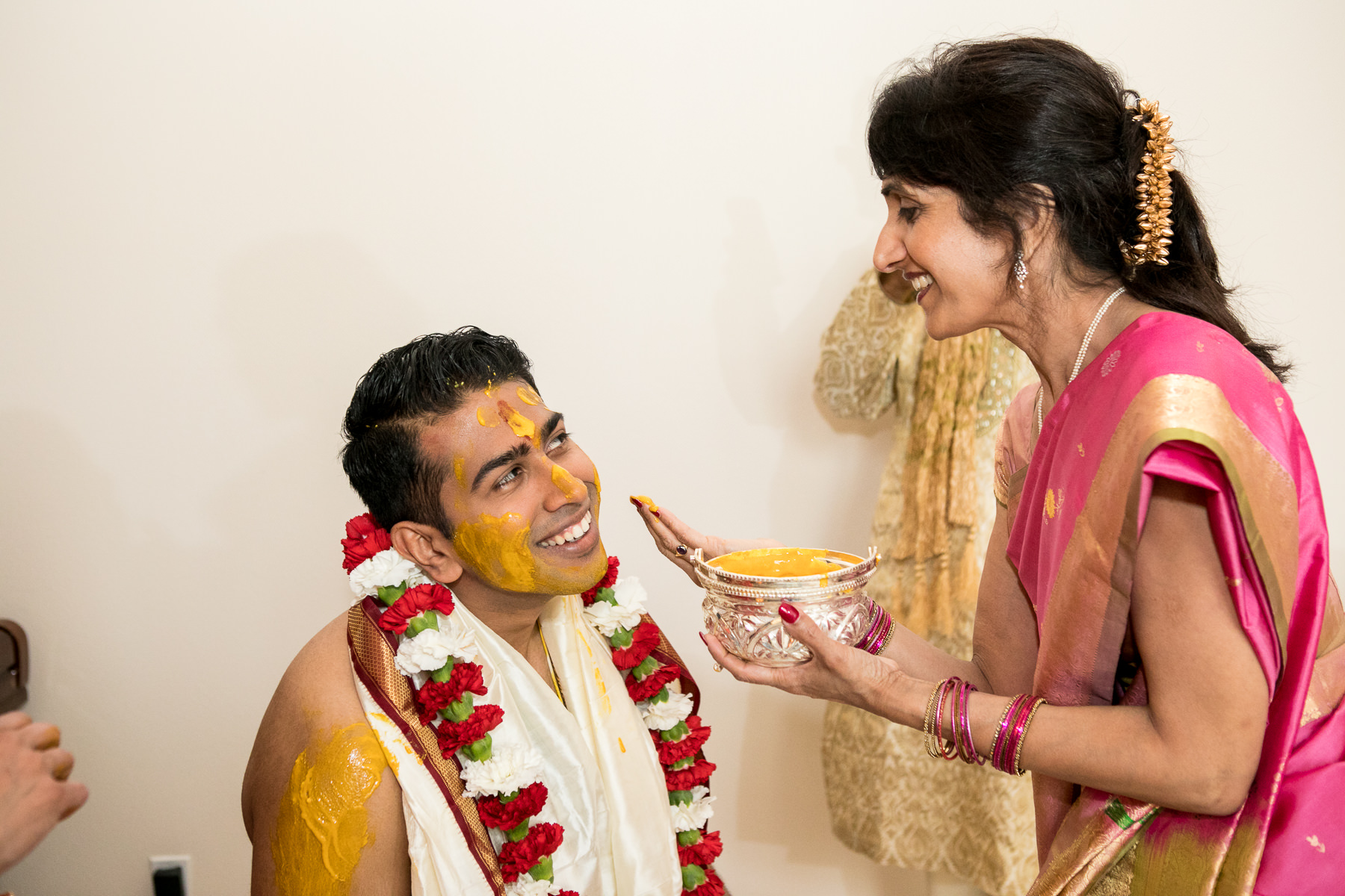 indian groom prepares for haldi from mother in law during indian wedding in whittier