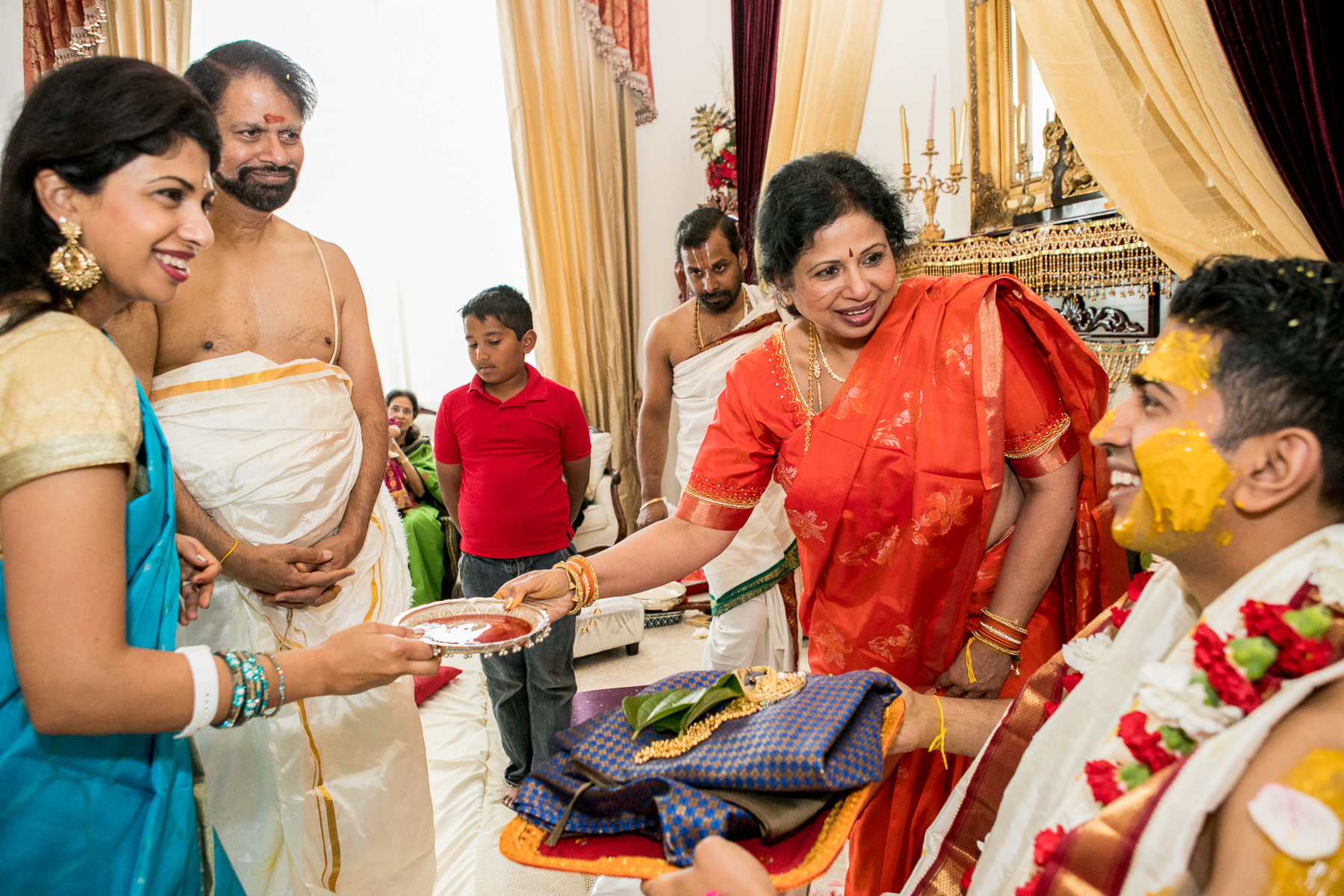 indian family presents clothes to groom in whittier wedding photography
