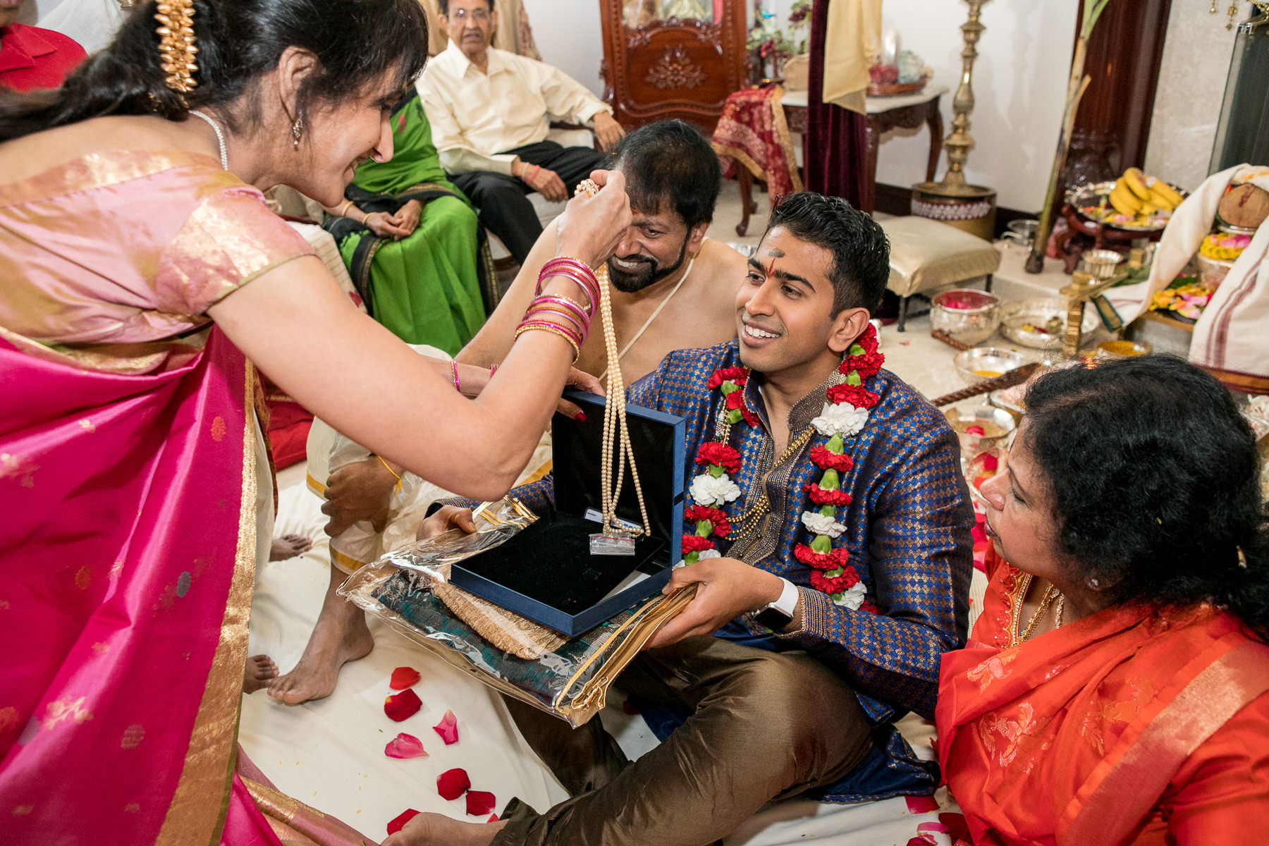 gift of pearls to indian groom by mother in law during indian wedding ritual
