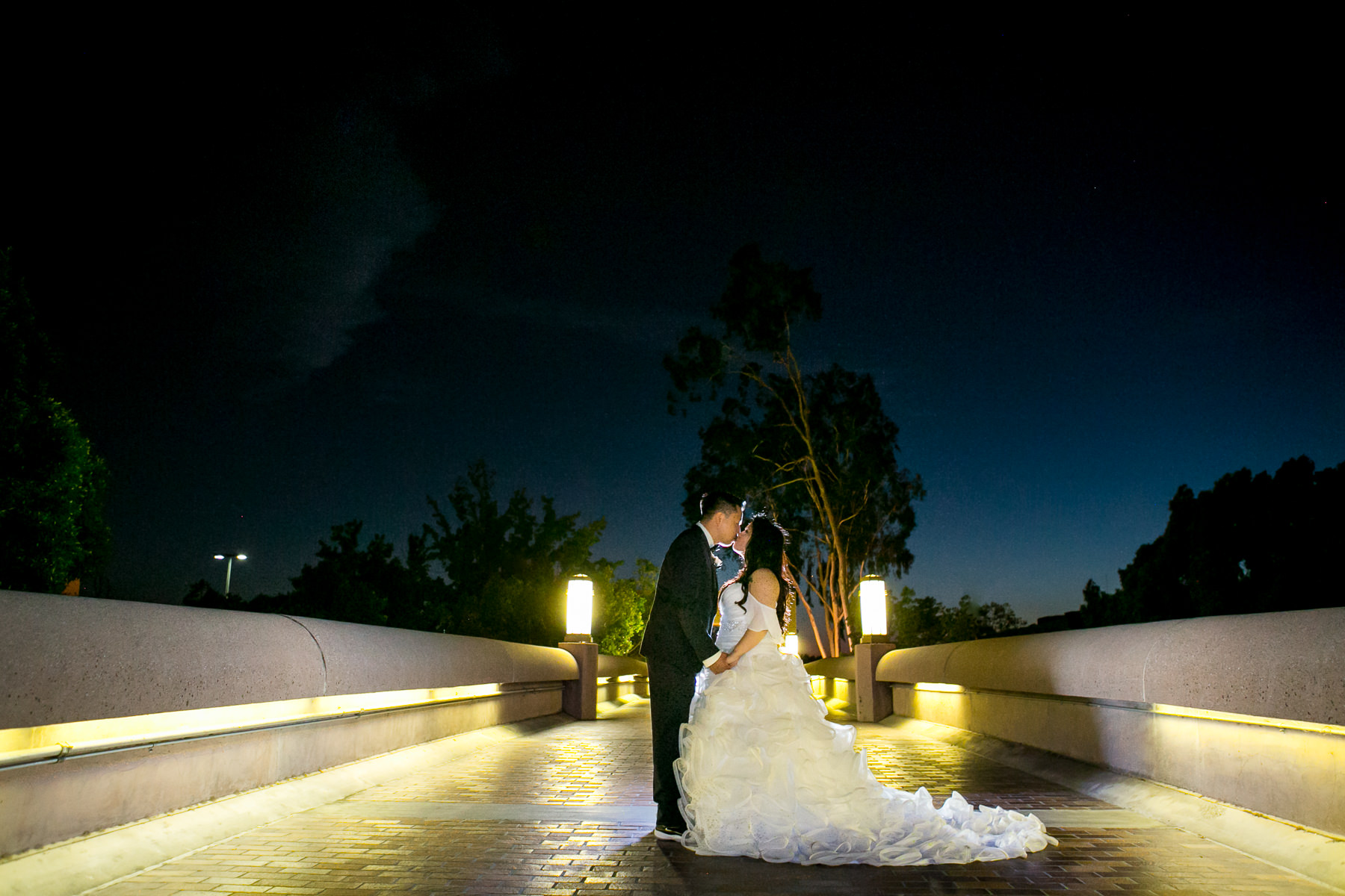 night portrait of intimate kiss of bride and groom for wedding at noor pasadena photographer