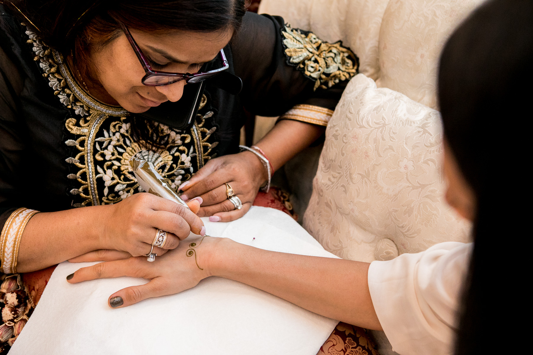 henna artist begins design during mendhi ceremony in whittier wedding photographer