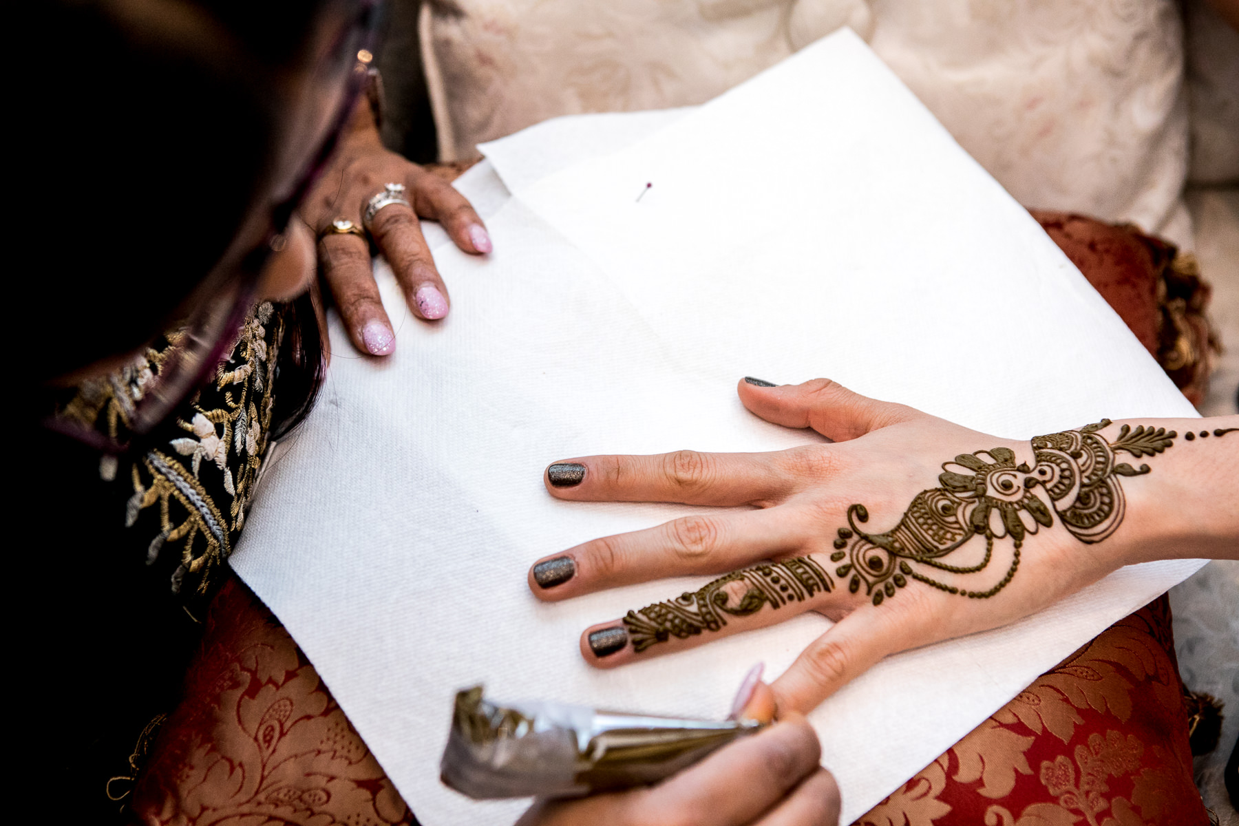 intricate henna design during mendhi ceremony wedding photographer