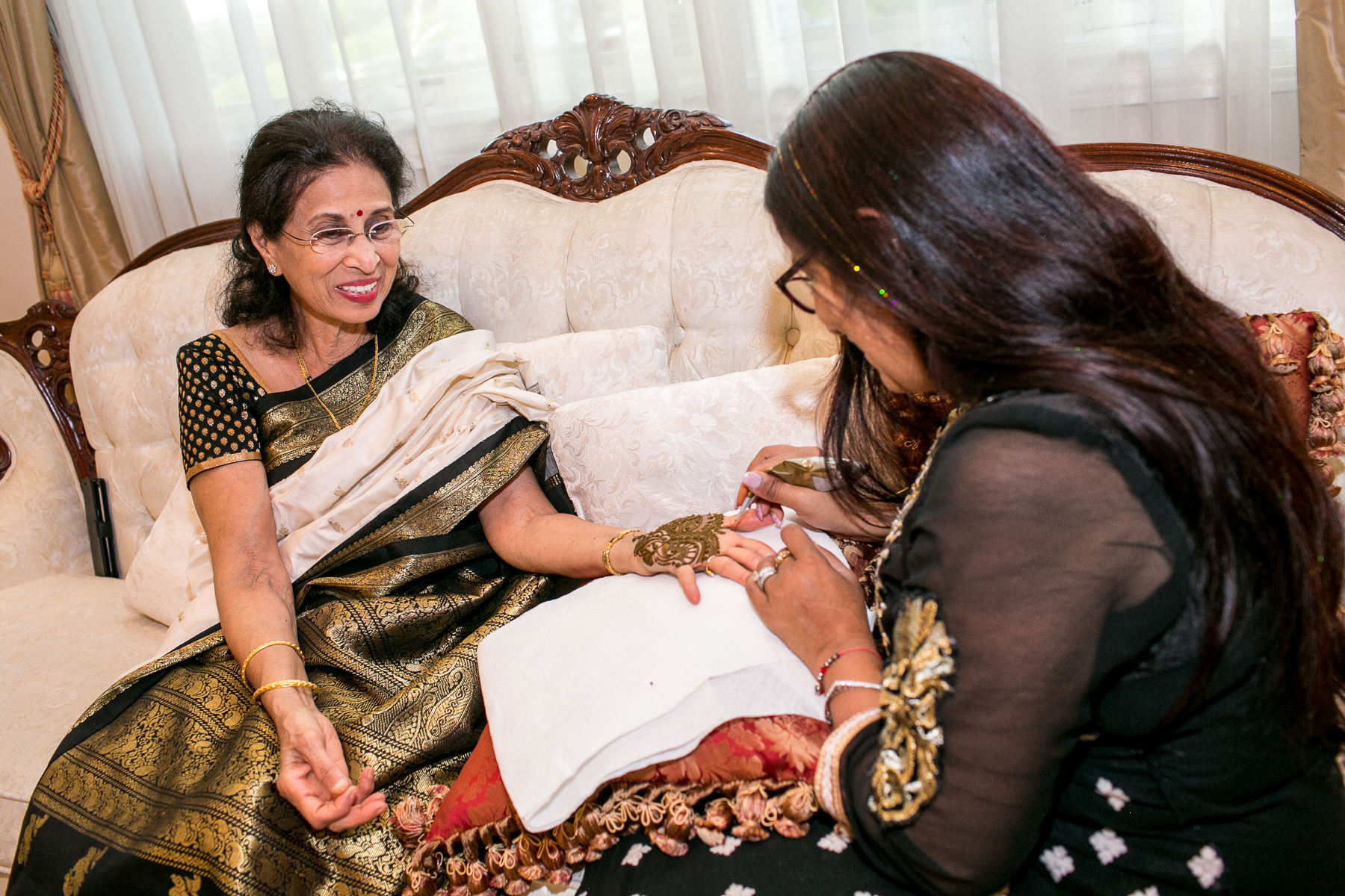 woman receives henna on palm during mendhi ceremony in whittier wedding photographer