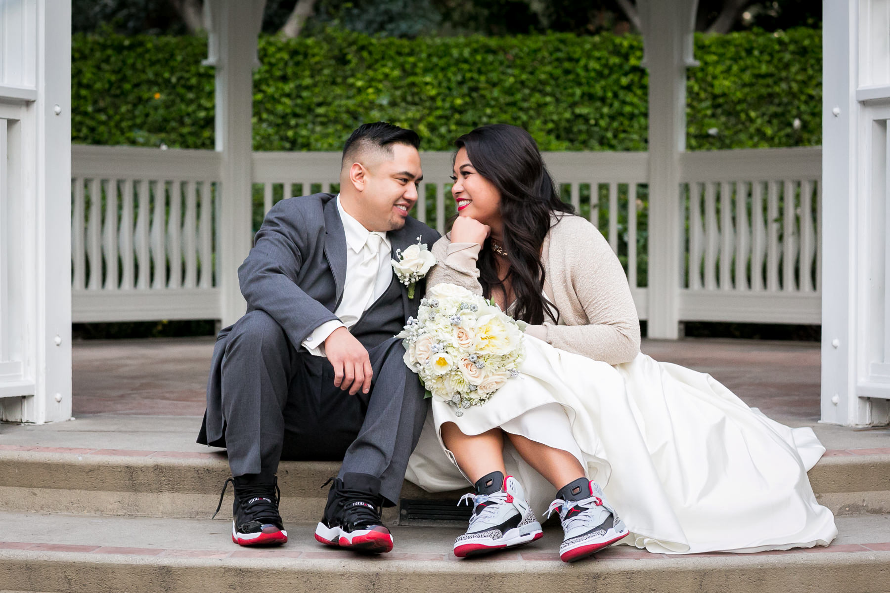 Lovely Portrait Of Bride And Groom Showing Shoes Disneyland Wedding Photos