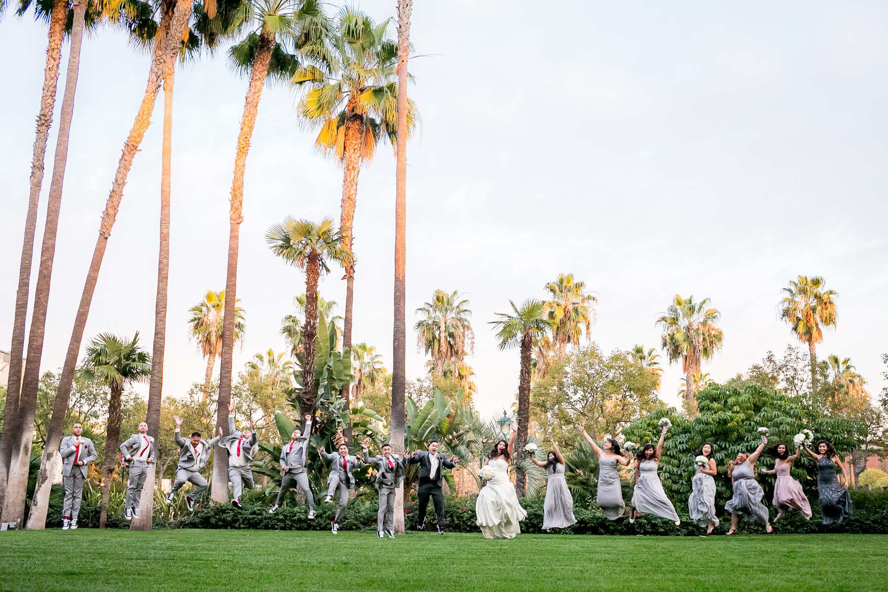Fun Jumping Shot Of The Bridal Party On Disneyland Hotel Lawn Wedding