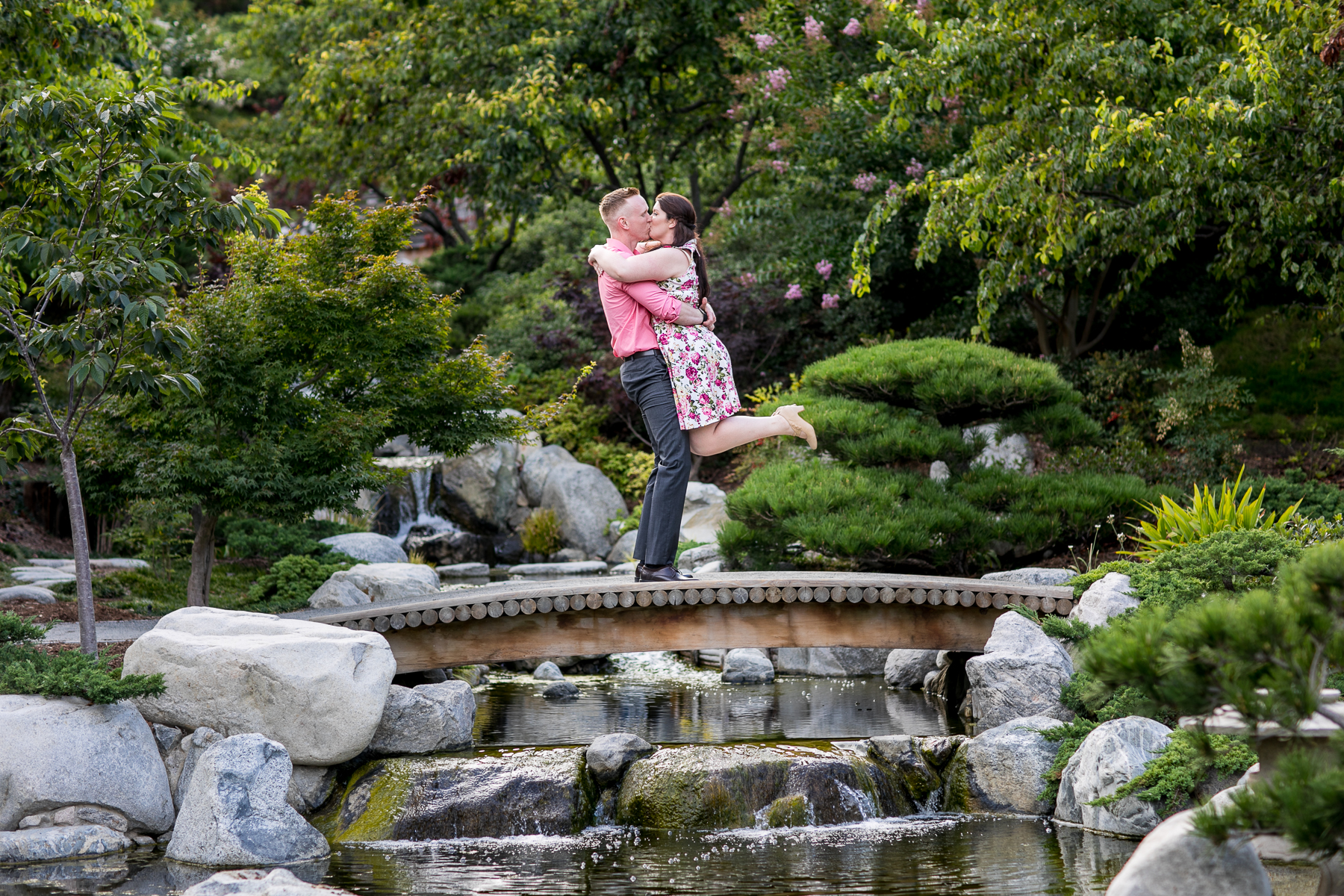 guy lifts girl off feet at balboa park engagement session in san diego