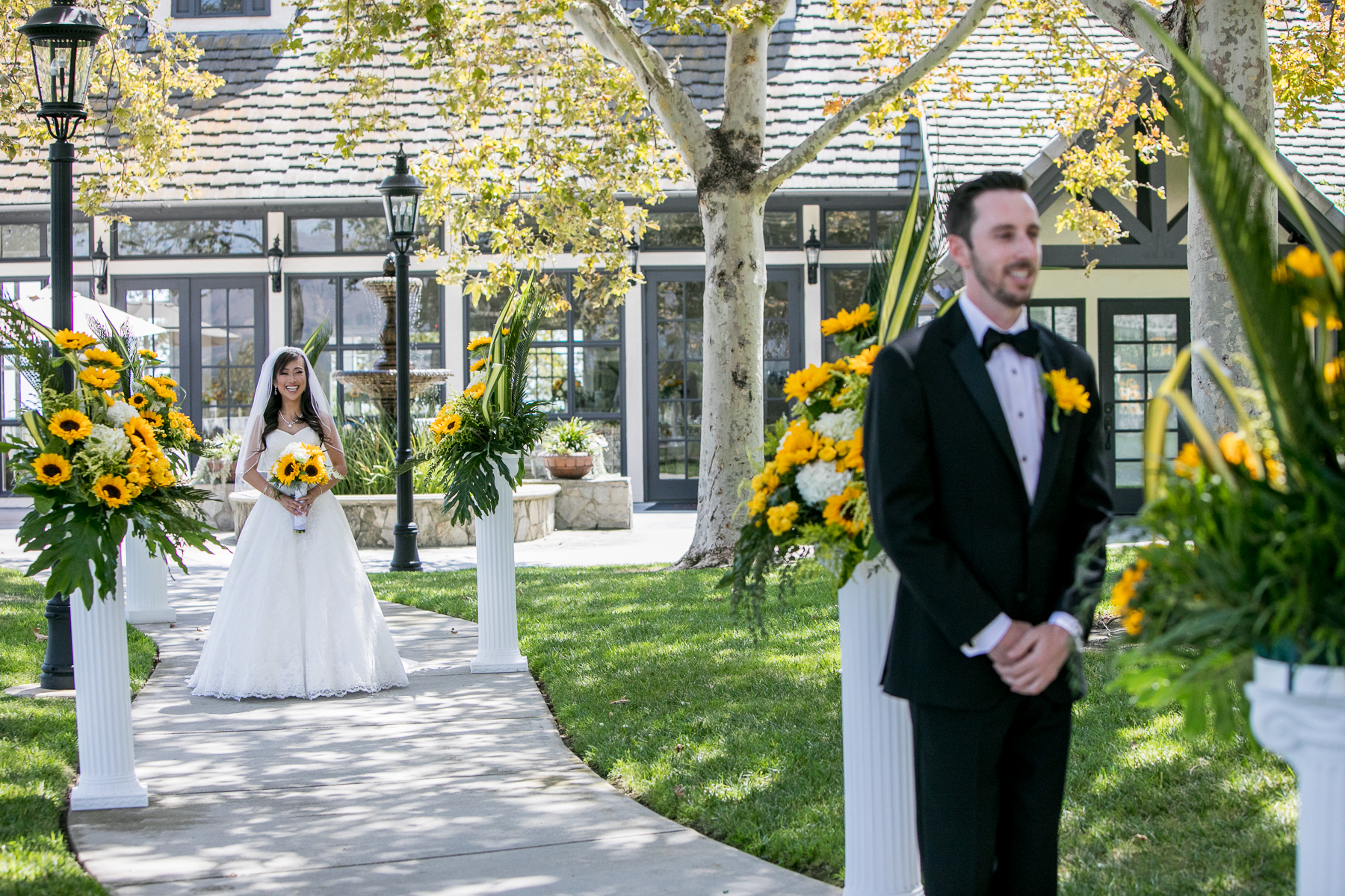 sunflower themed wedding at summit house first look bride and groom