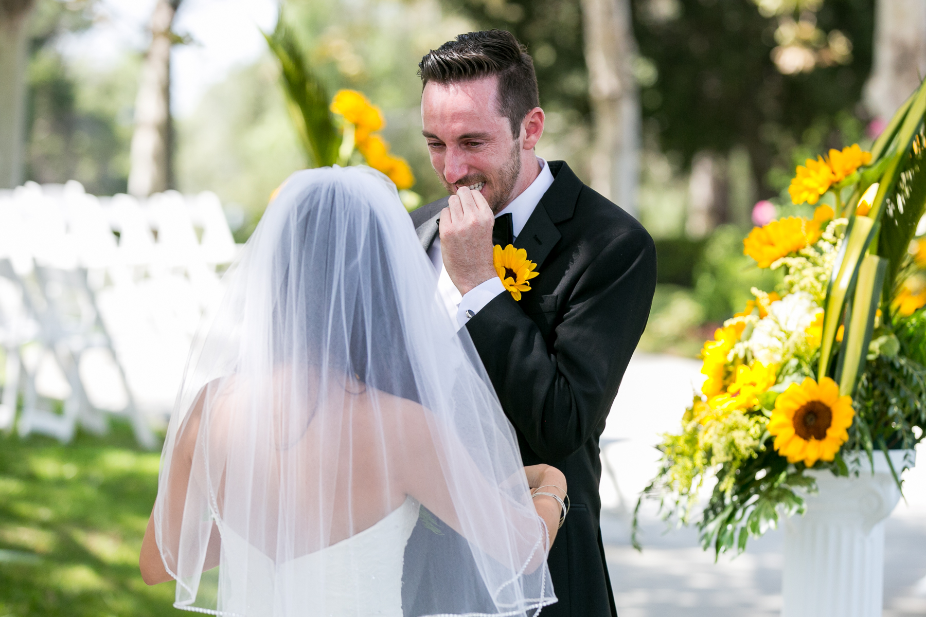 groom emotional during first look at summit house wedding photos