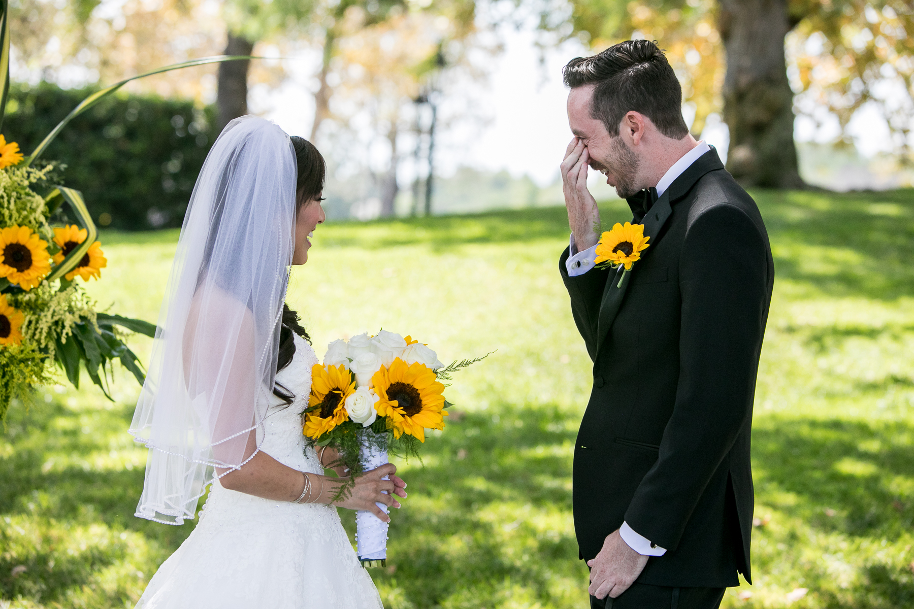 groom wipes tears during emotional first look at summit house wedding photographer