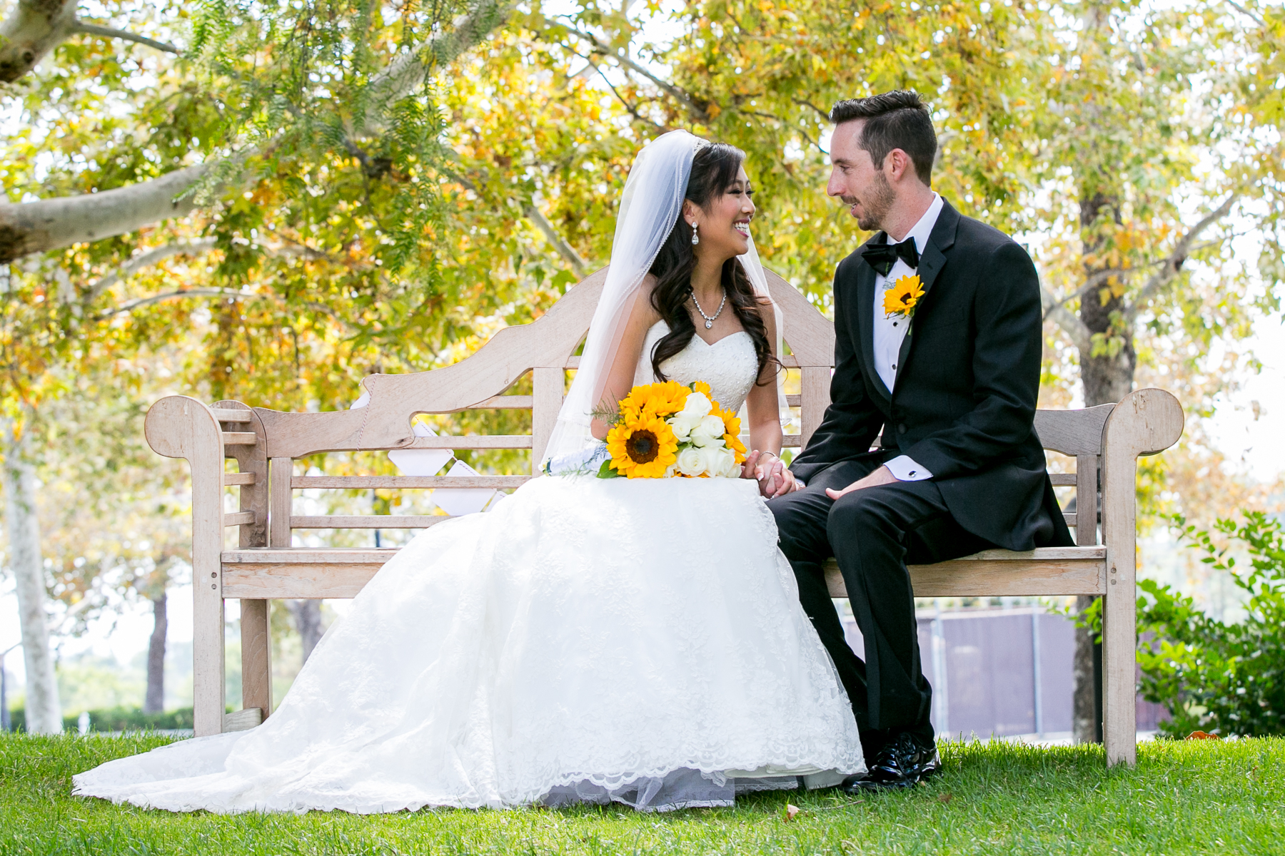 bride and groom gaze into each others eyes on bench at summit house wedding photographer