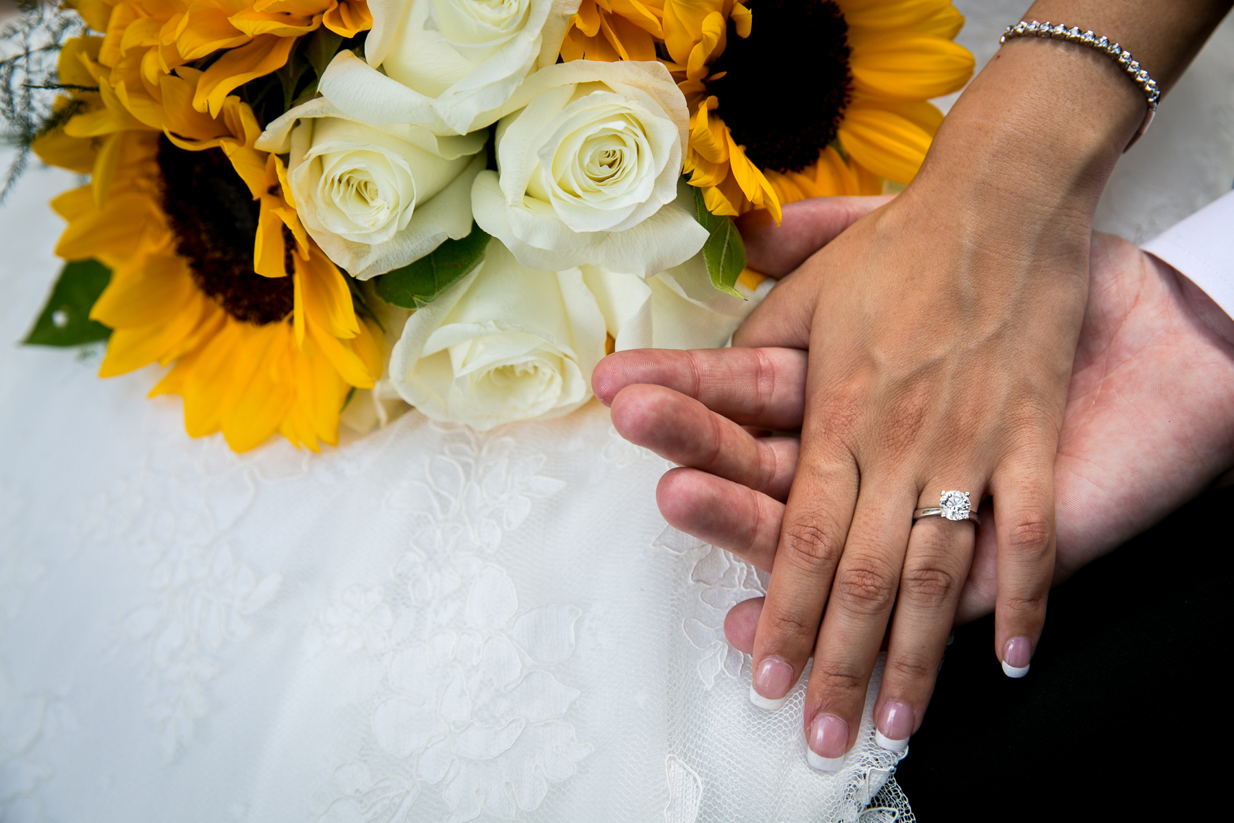 closeup of ring and flowers at wedding at summit house photos