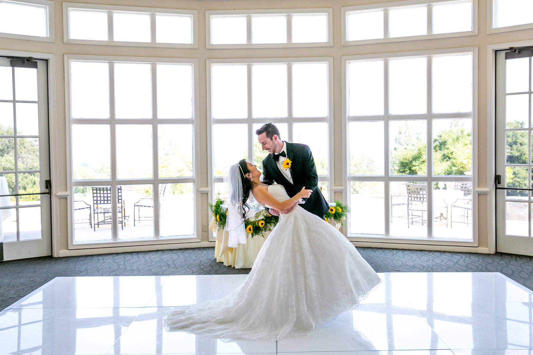 groom dips bride on dance floor at reception of summit house wedding pictures