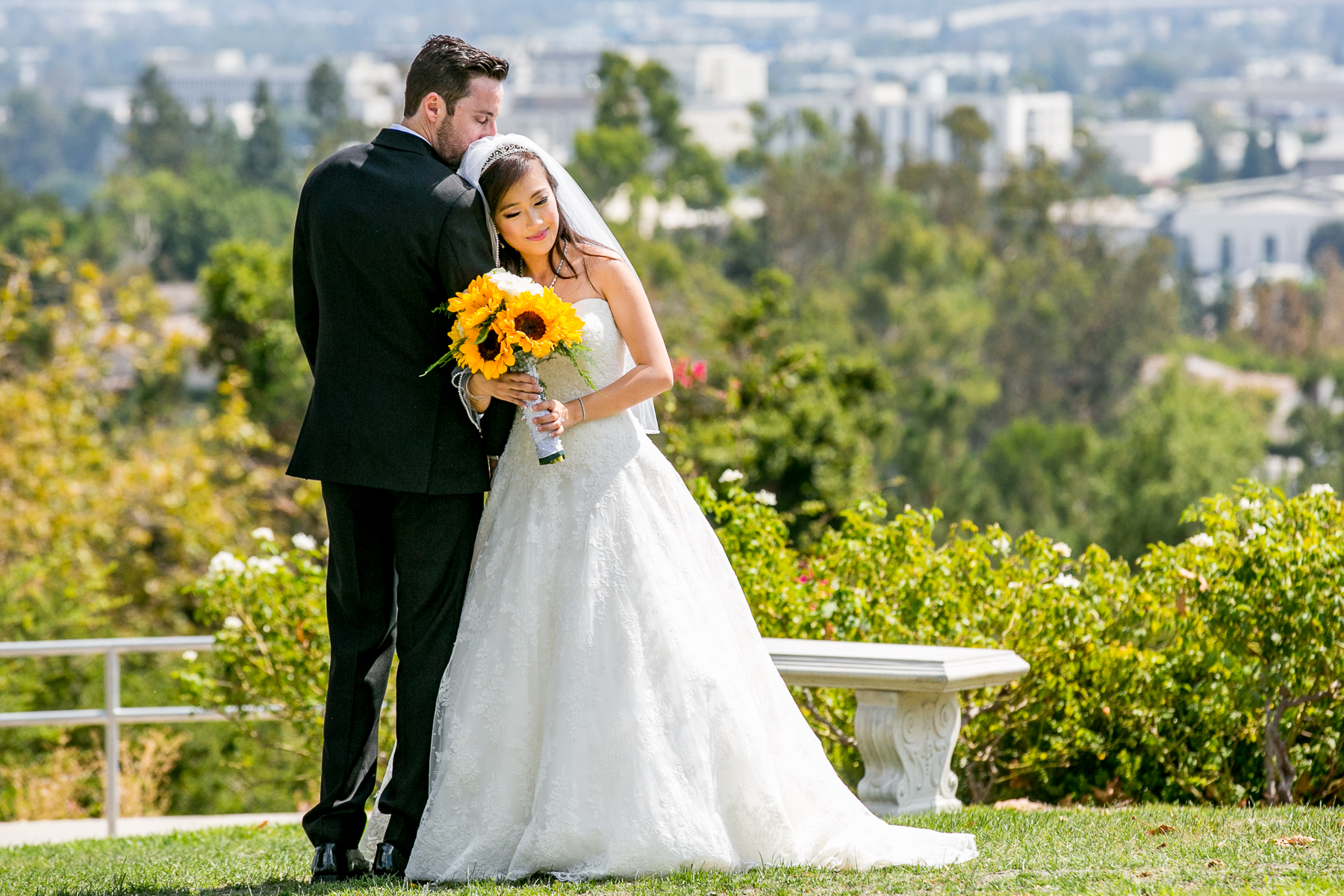 bride and groom pose with city in background of summit house wedding fullerton