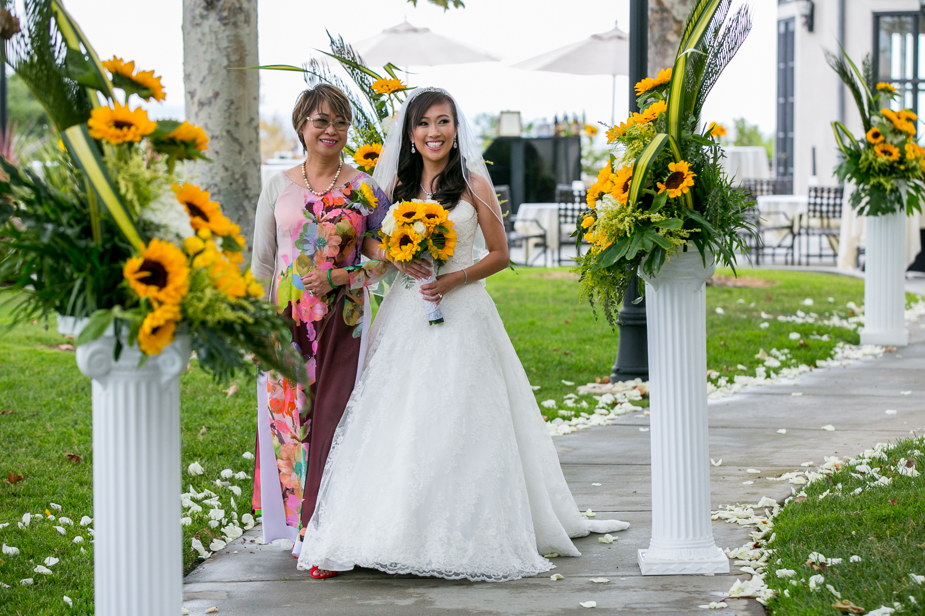 bride walks down aisle with mother who is also florist at summit house wedding photographer