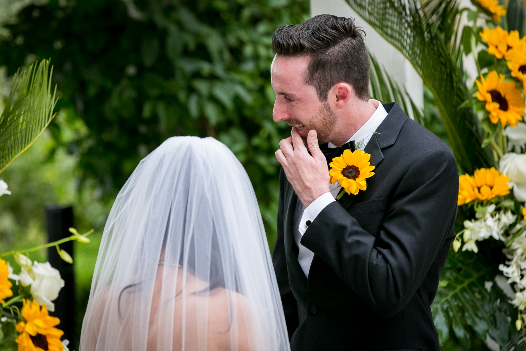 groom gets emotional during wedding vows at summit house fullerton photography