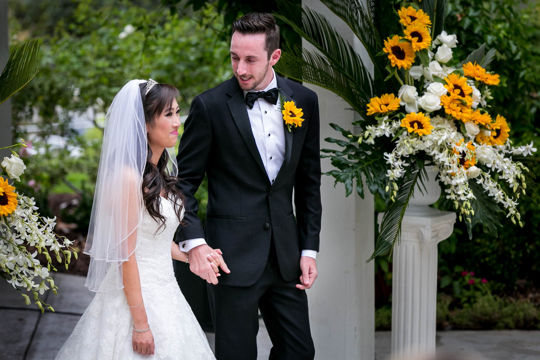 groom looks back at bride at wedding ceremony at summit house
