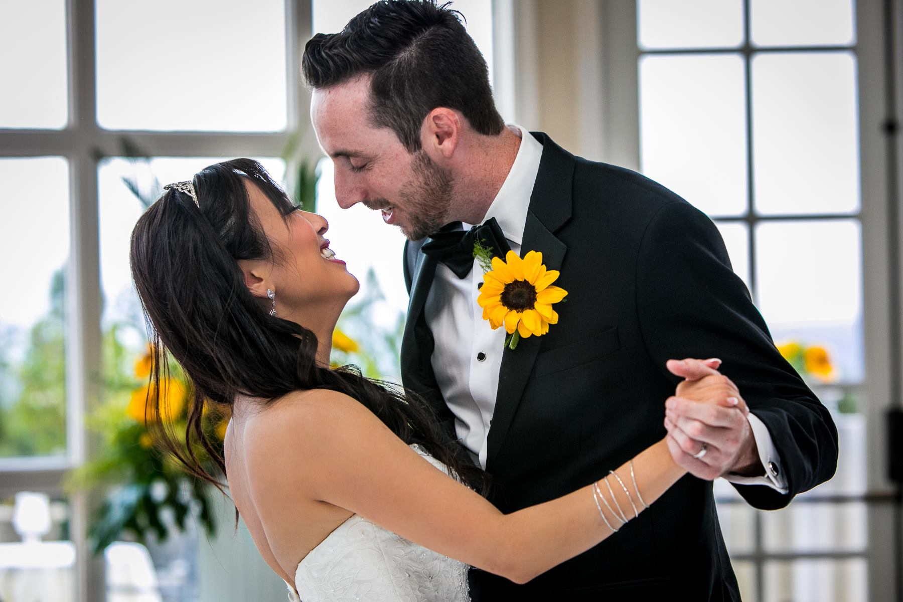 groom leans into bride during first dance at reception of wedding at summit house photos