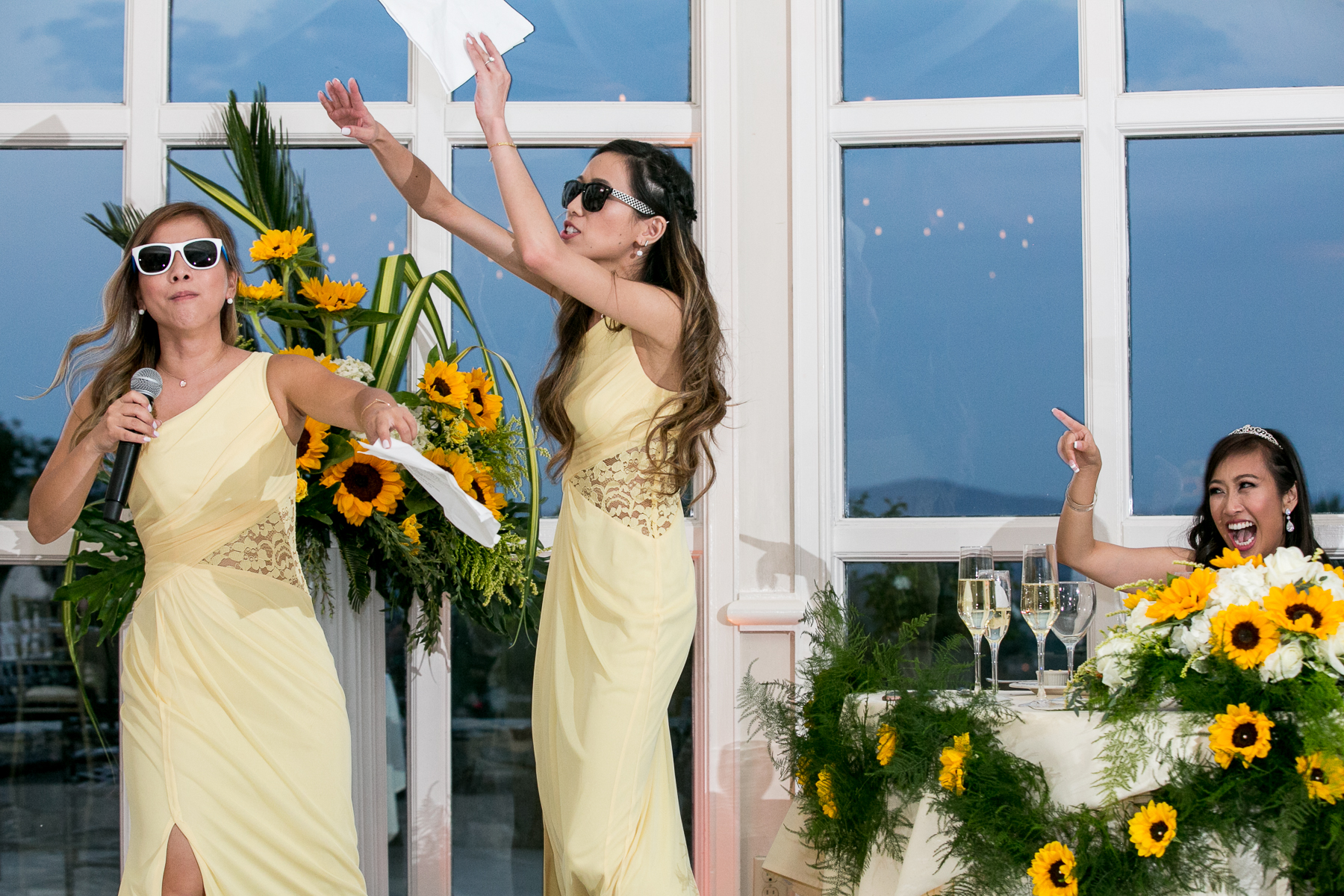 bridesmaids bust in song during speech during wedding reception at summit house