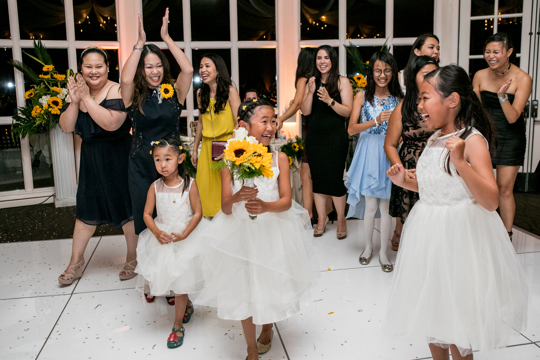 flower girl catches bridal bouquet at wedding reception at summit house fullerton