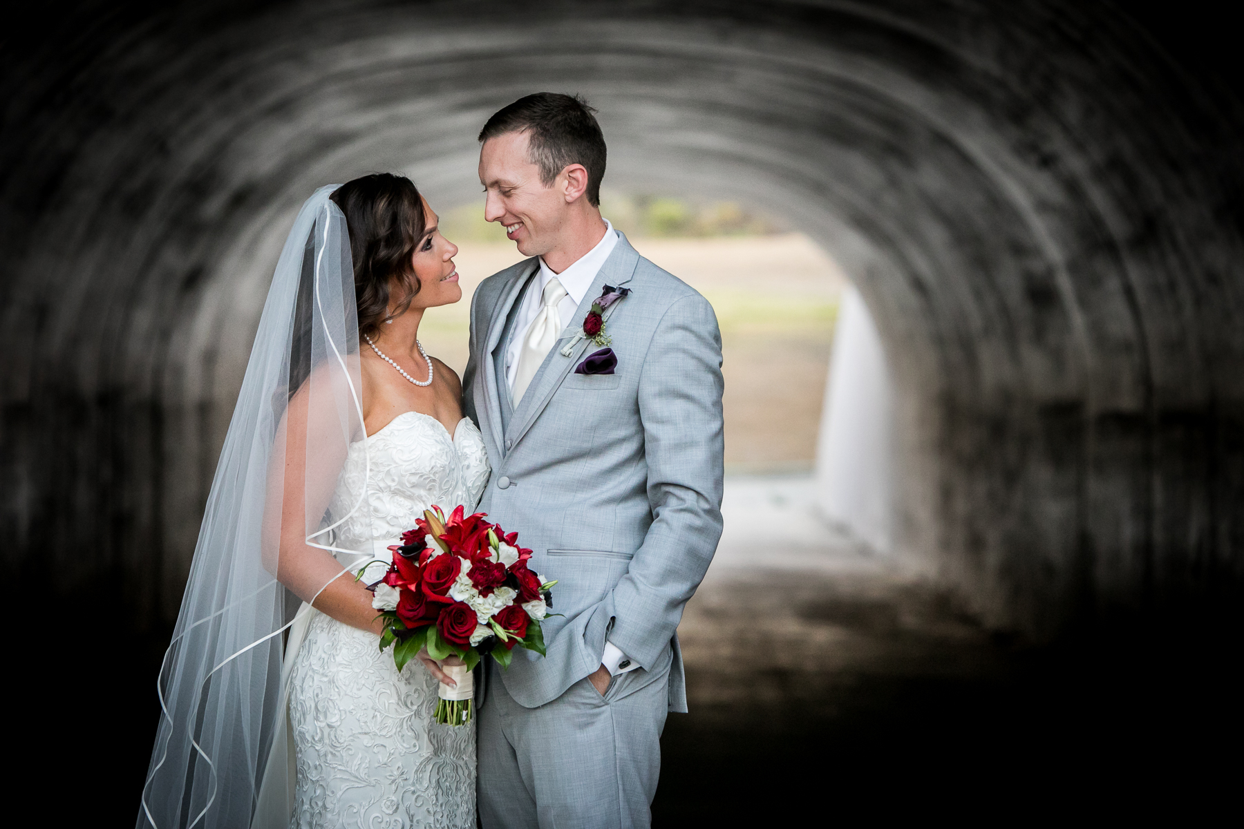 bride and groom portrait under tunnel at wedding at the champion's club at the retreatphotos