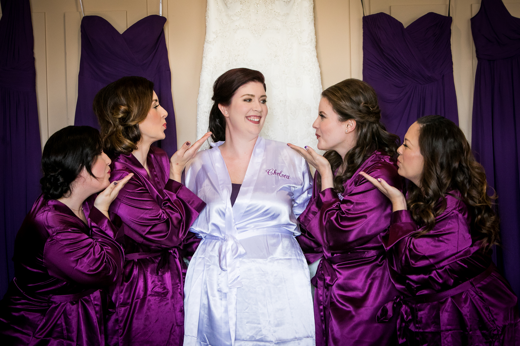 bridesmaids blow kiss to bride in robes dresses getting ready at dove canyon photographer