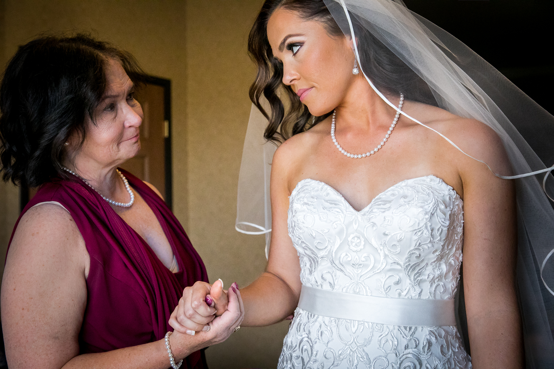 bride and mother of bride share moment during getting ready at wedgewood wedding photographer