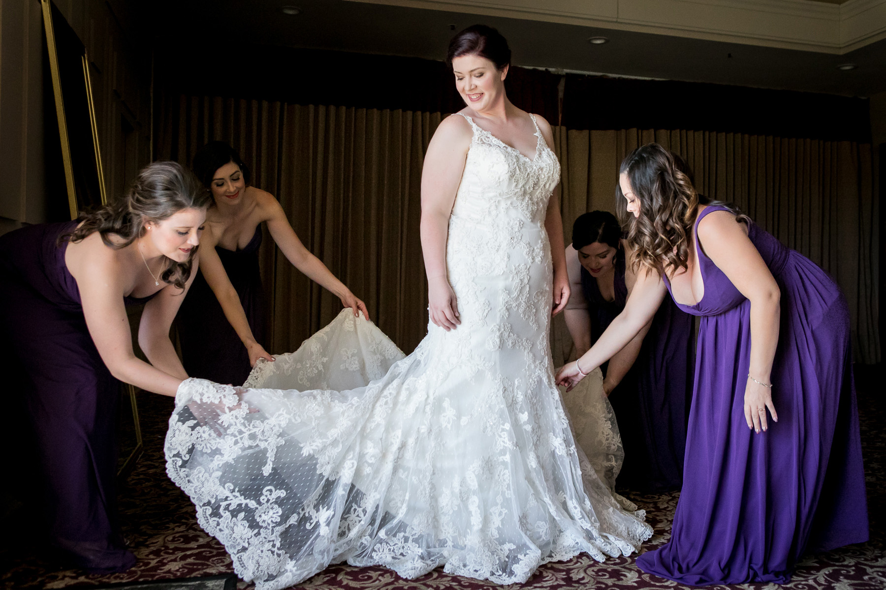 bridesmaids fluff wedding dress at wedding at rancho santa margarita wedding photos
