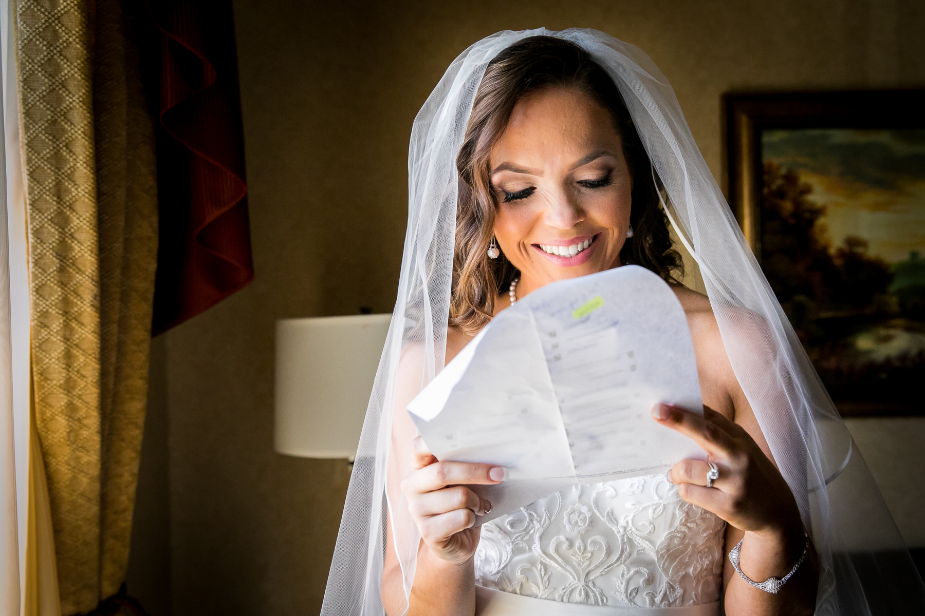 bride smiles during card exchange with groom at ayres wedding photographer