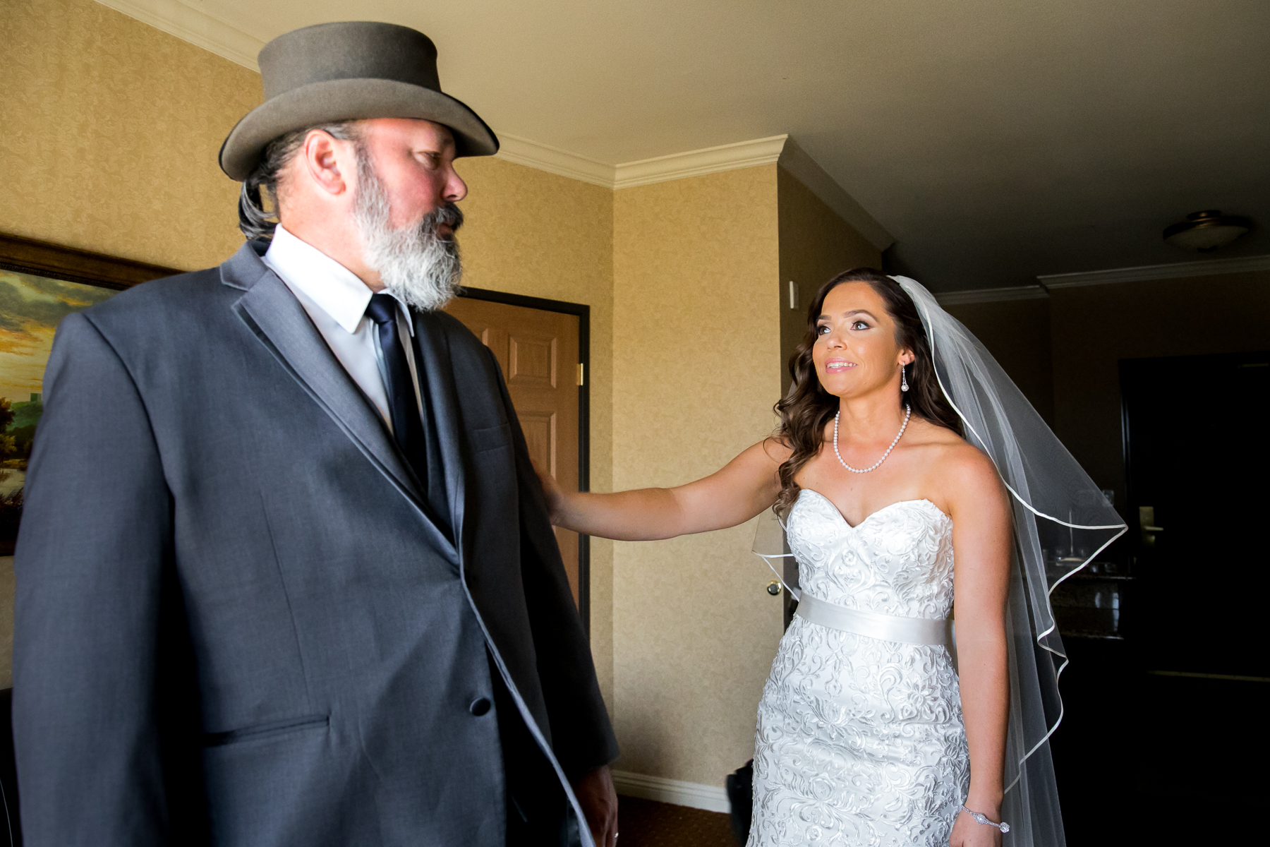 bride first look with dad at wedding in ayres hotel in corona