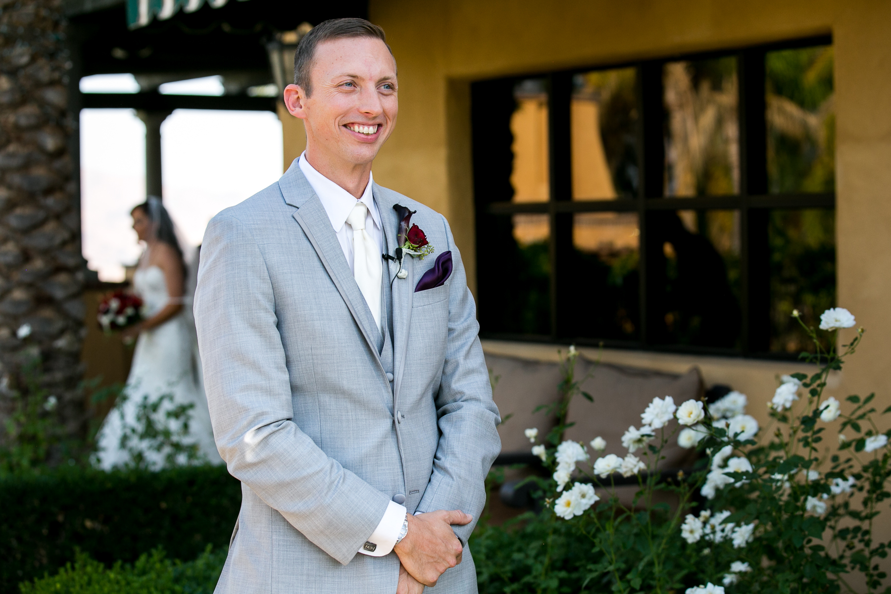 groom anxiously awaits his bride during the first look at champion's club at the retreat wedding photos