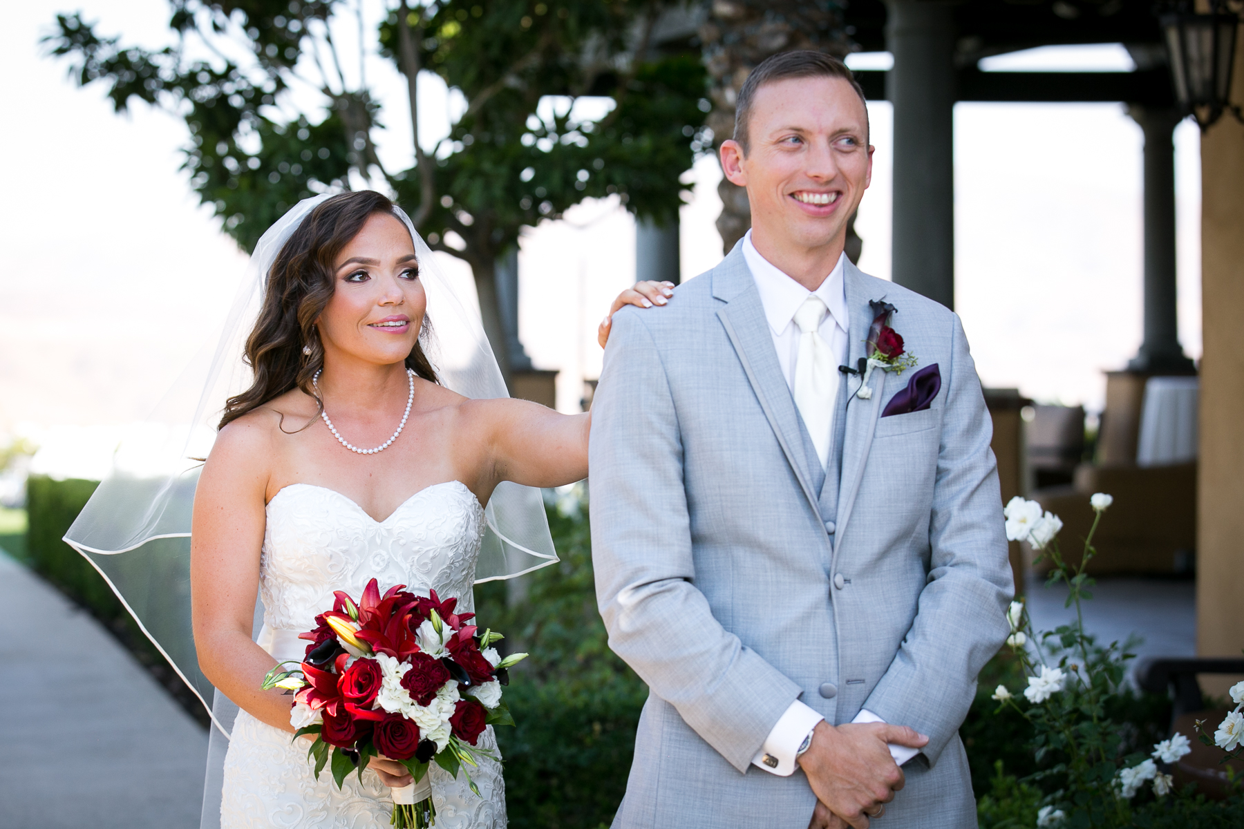 moment bride taps groom on shoulder at first look at wedding at wedgewood in corona photos