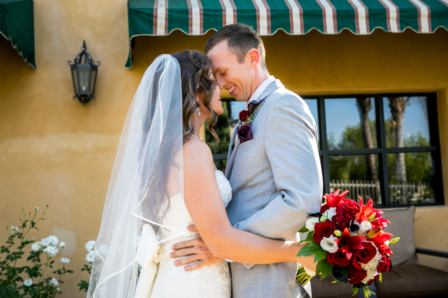 bride and groom intimate moment during first look at corona wedding photographer