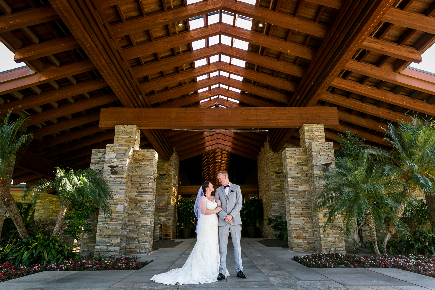 wide portrait of bride and groom in front of dove canyon golf club wedding photographer